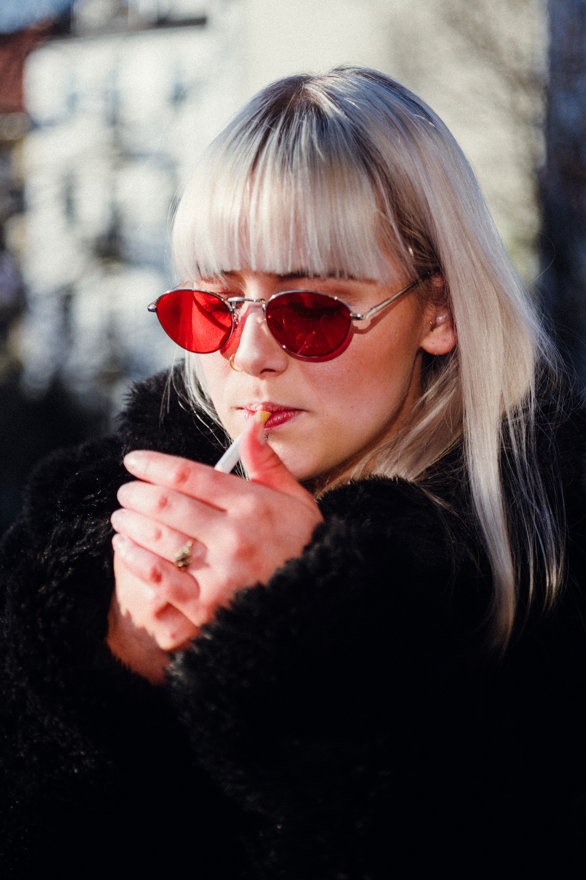 Liz' red glasses - & a cigarette on the balcony