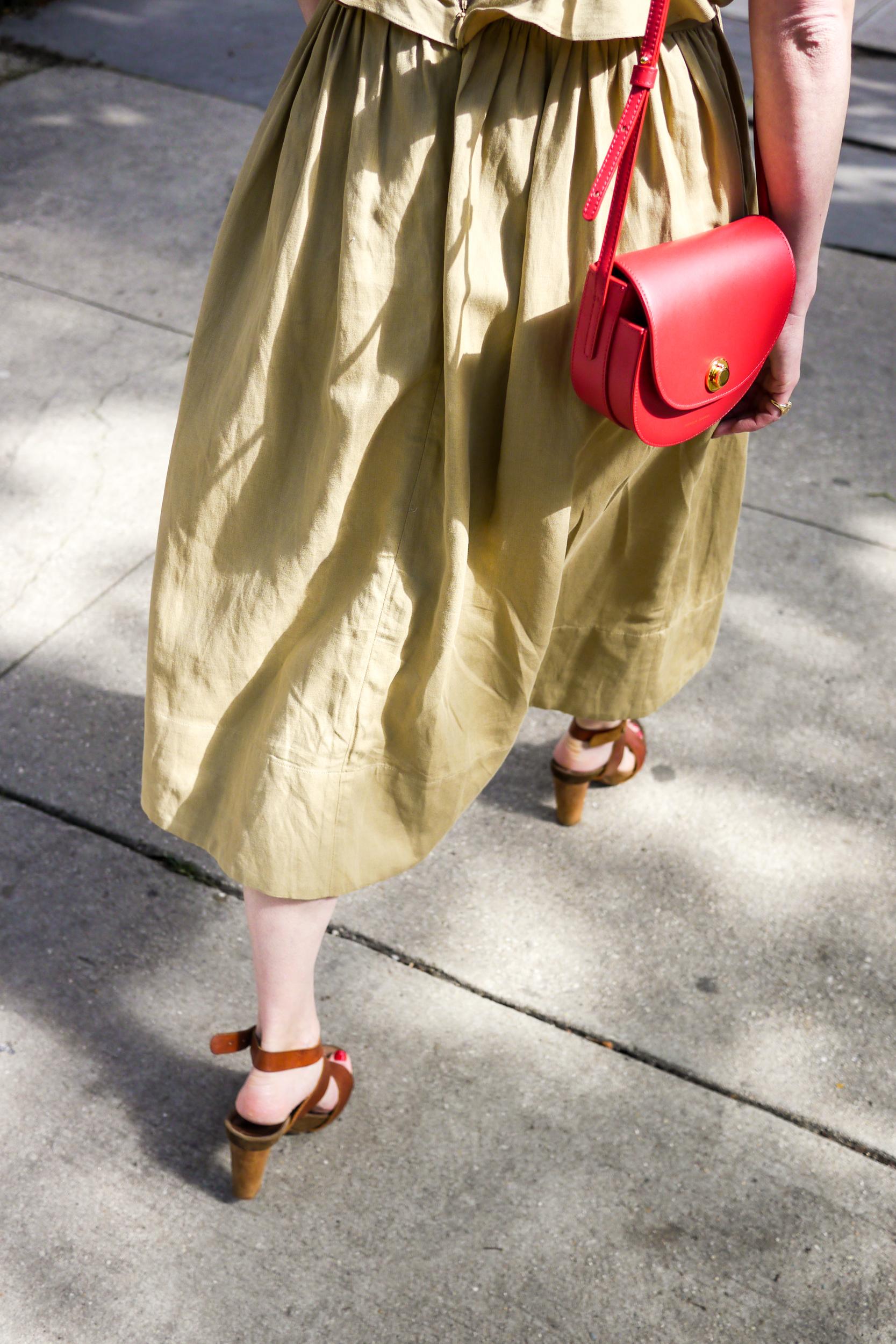 Streetstyle Details:    Dress, Ulla Johnson   ;    Shoes, Handmade   ;    Bag, Mansur Gavriel   ;    Earrings, Kathleen Whitaker