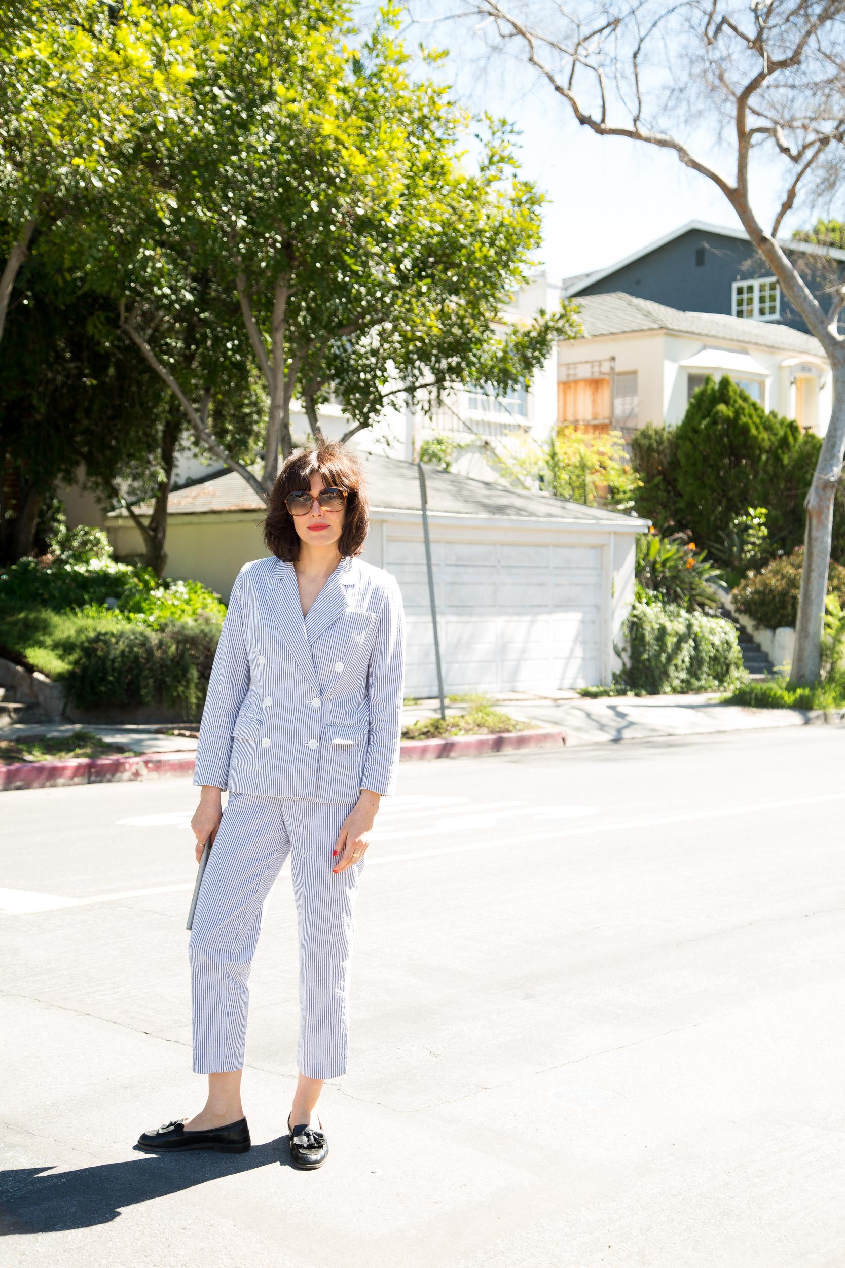 Suit:  Vintage, S unglasses: Vintage, Clutch: Vivienne Westwood
