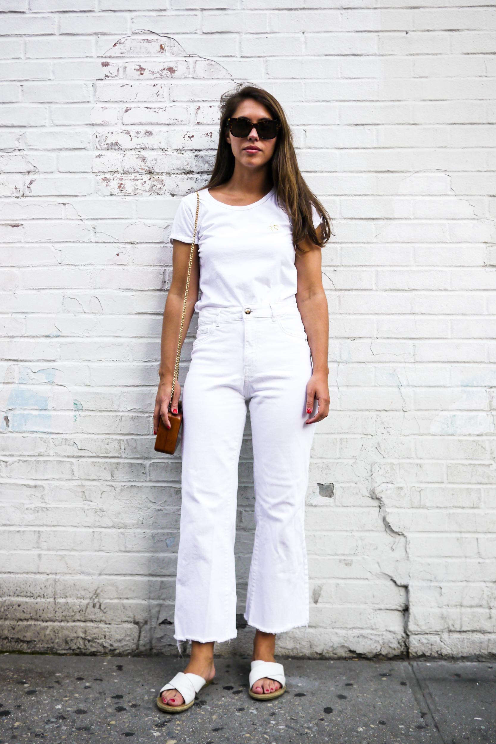 Top:    Maison Labiche Banana T Shirt   ; Jeans:    DL 1961 Hepburn High Rise Wide Leg Jeans   ; Clutch: Orphelia Square Wood Clutch