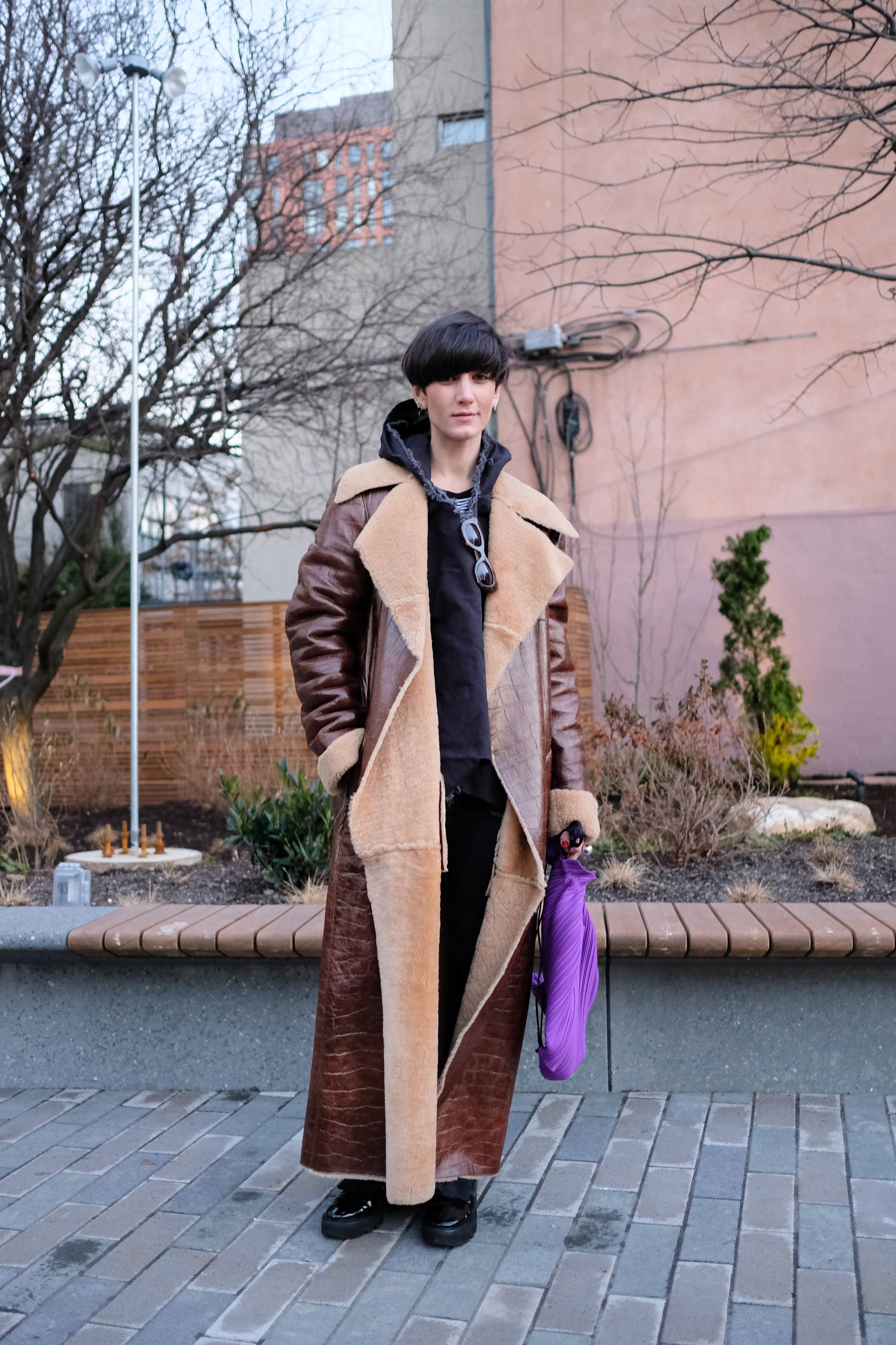 Coat, Vintage Escada from    TheRealReal    ; Hoodie, Vintage ; Jeans, Vintage Levi's ; Bag,    Pleats Please    ; Boots, Walter Steiger