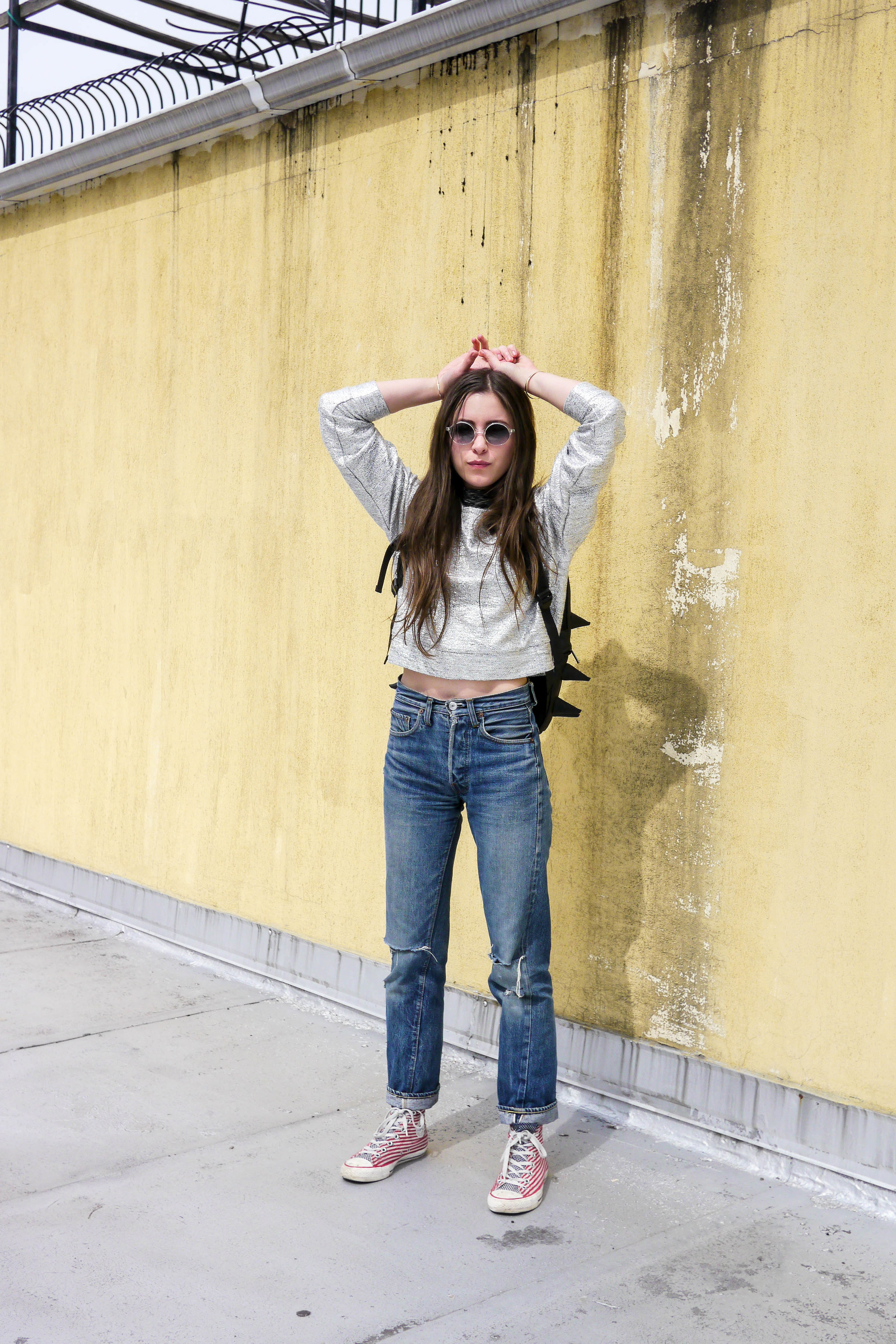 Top, Outdoor Voices    ;    Sweatshirt, Samuji    ;    Jeans, LEvi's    ;    Shoes, Converse    ;    Backpack, Madpax    ;    Sunglasses, Warby Parker