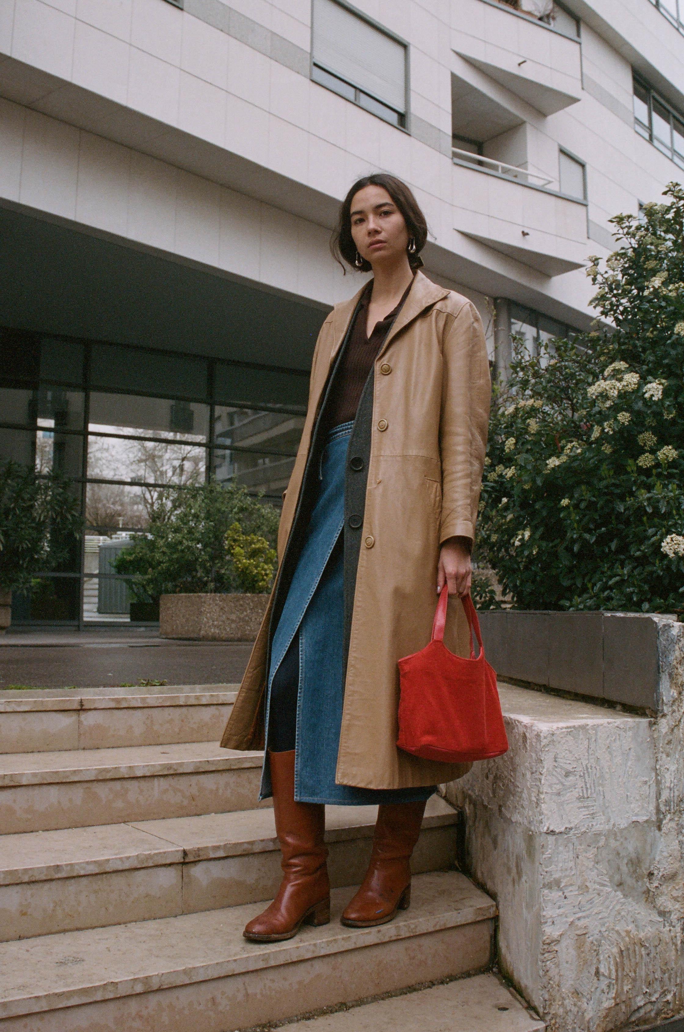 Top, Louis Vuitton ; Earrings,  Lemaire  ; Skirt, Jill Sander ; Boots,  APC  ; Coat, Vintage