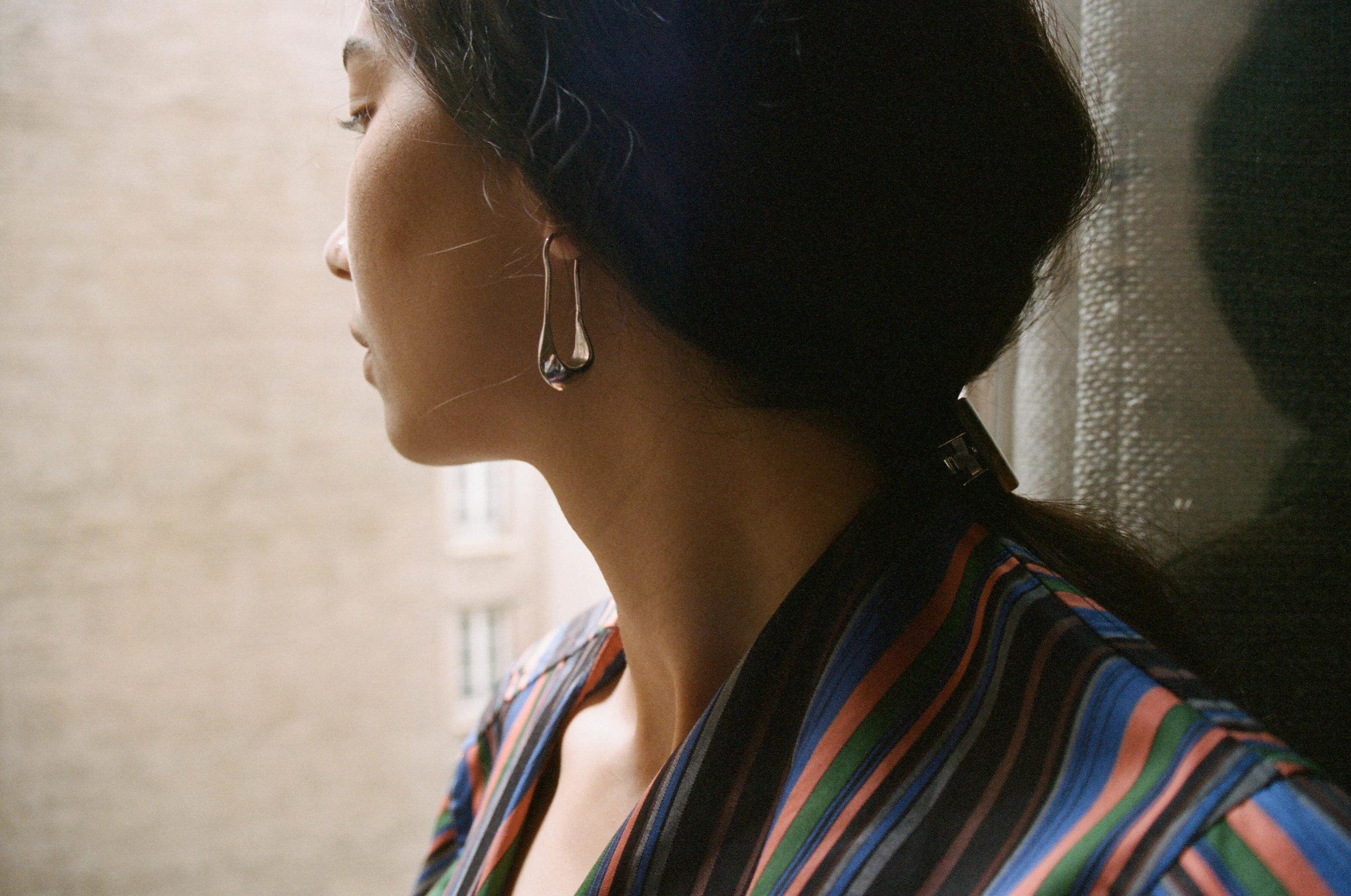 Earrings,  Lemaire  ; Dress, Liwan ; Barrette, MK2 Store