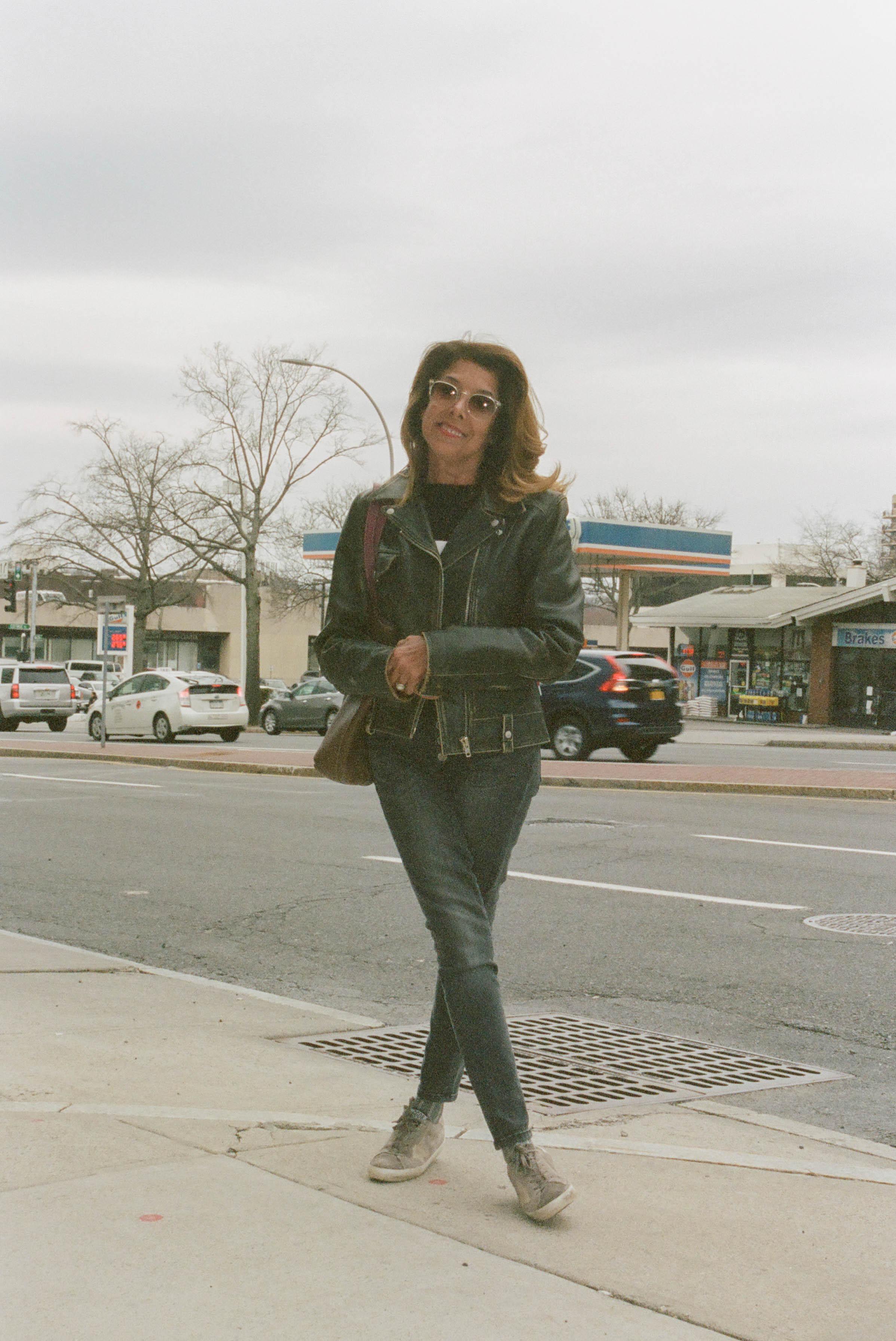 Sweater, Loewe ; Jacket, Tommy Hilfiger ; Jeans, Frame ; Shoes, Golden Goose ; Bag, Hermes