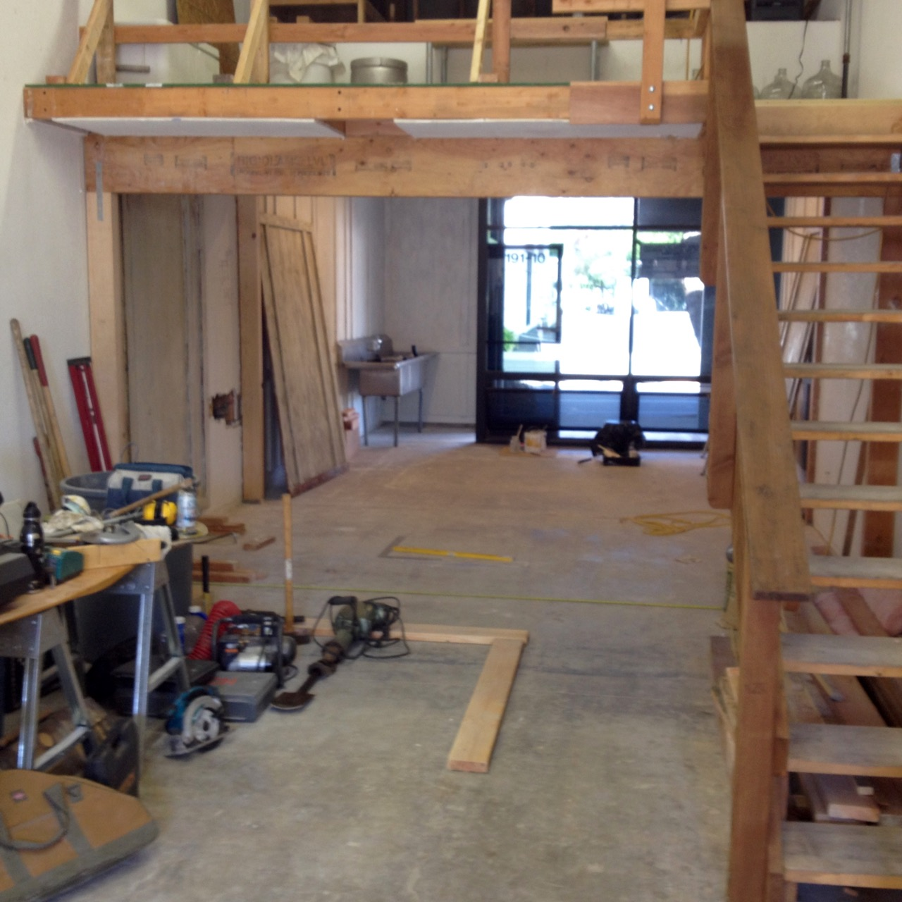 Making space: Walls removed and existing loft area supported.