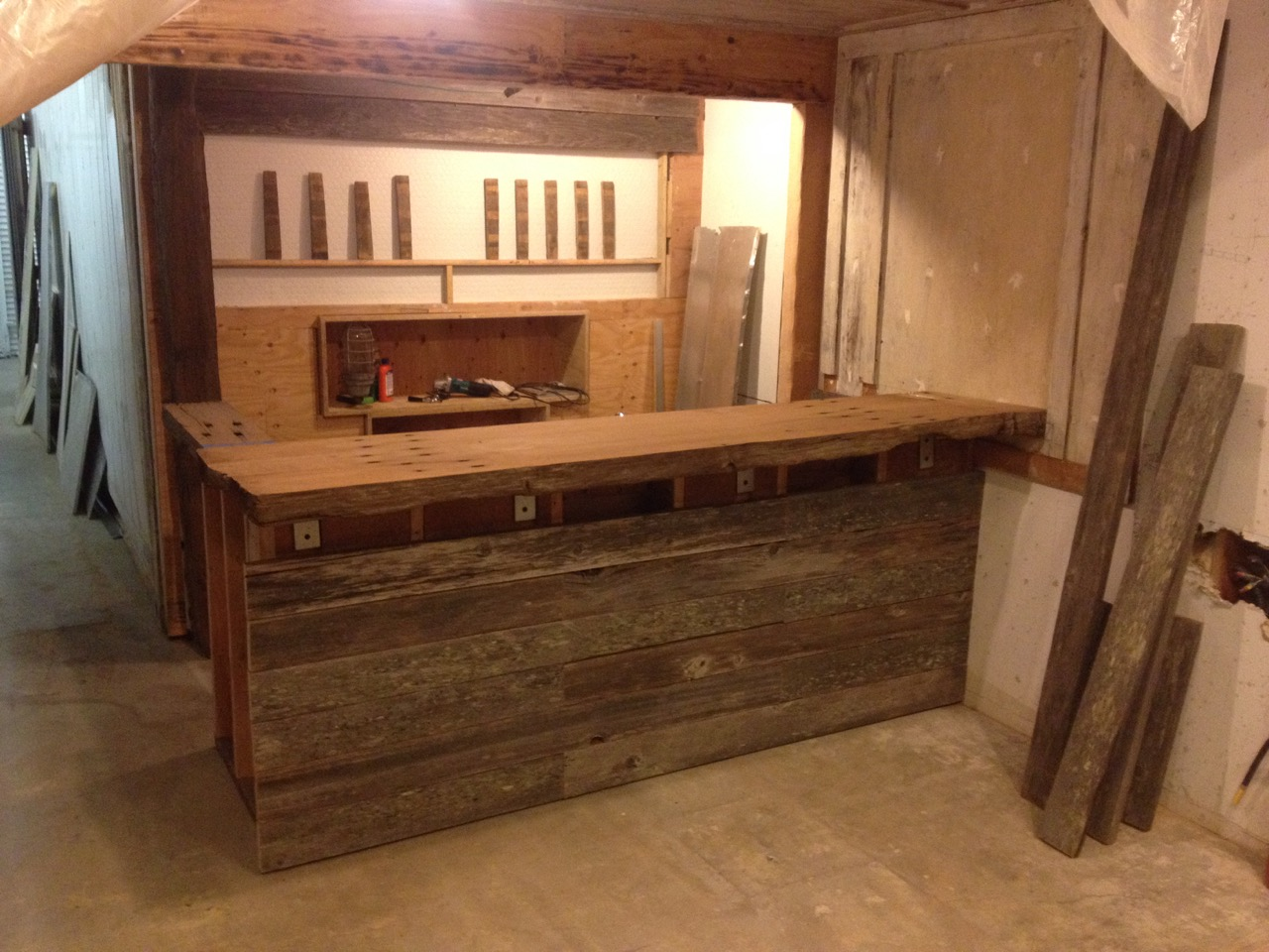 Staging: The taps are mocked up from old oak barrel staves, the face of the bar is salvaged pasture fencing.