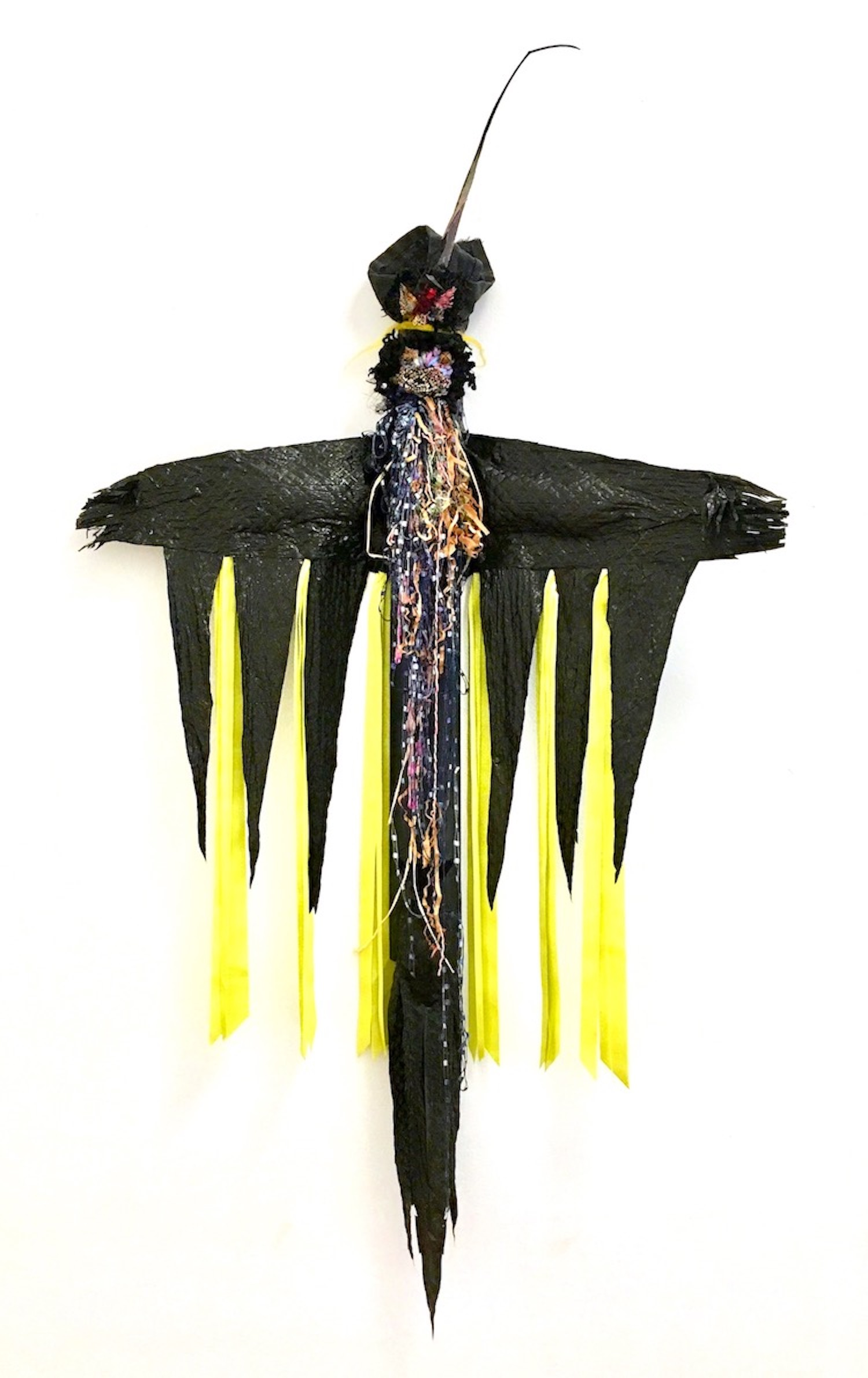 "Village Guardian   Black plastic bag, textiles, ribbon, felt, threads, rusty bell, cotton batting, fibers, found objects, and acrylic gel on cardboard  40 x 24 x 4""  2019"