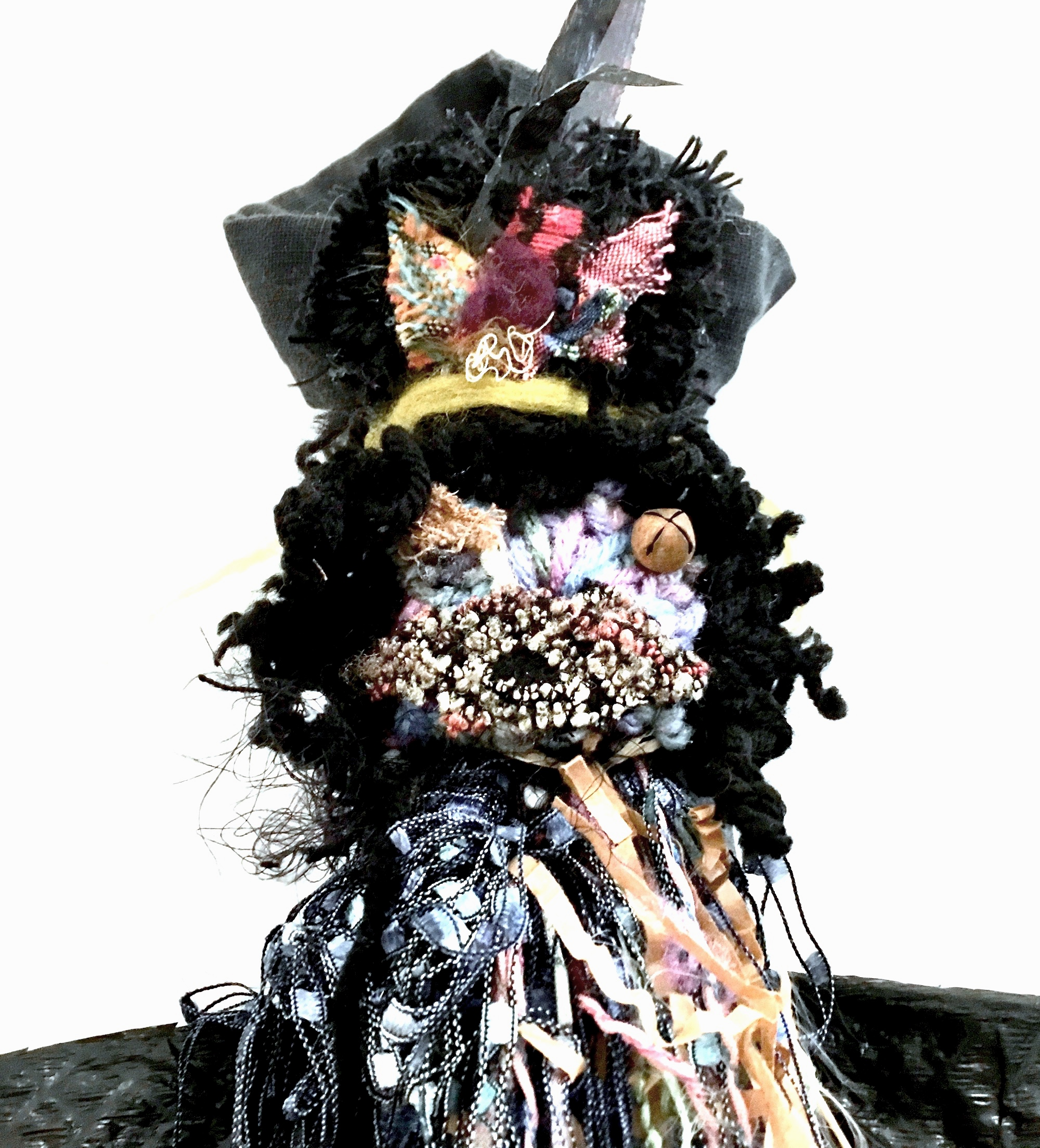 "Village Guardian (Detail)   Black plastic bag, textiles, ribbon, felt, threads, rusty bell, cotton batting, fibers, found objects, and acrylic gel on cardboard  40 x 24 x 4""  2019"