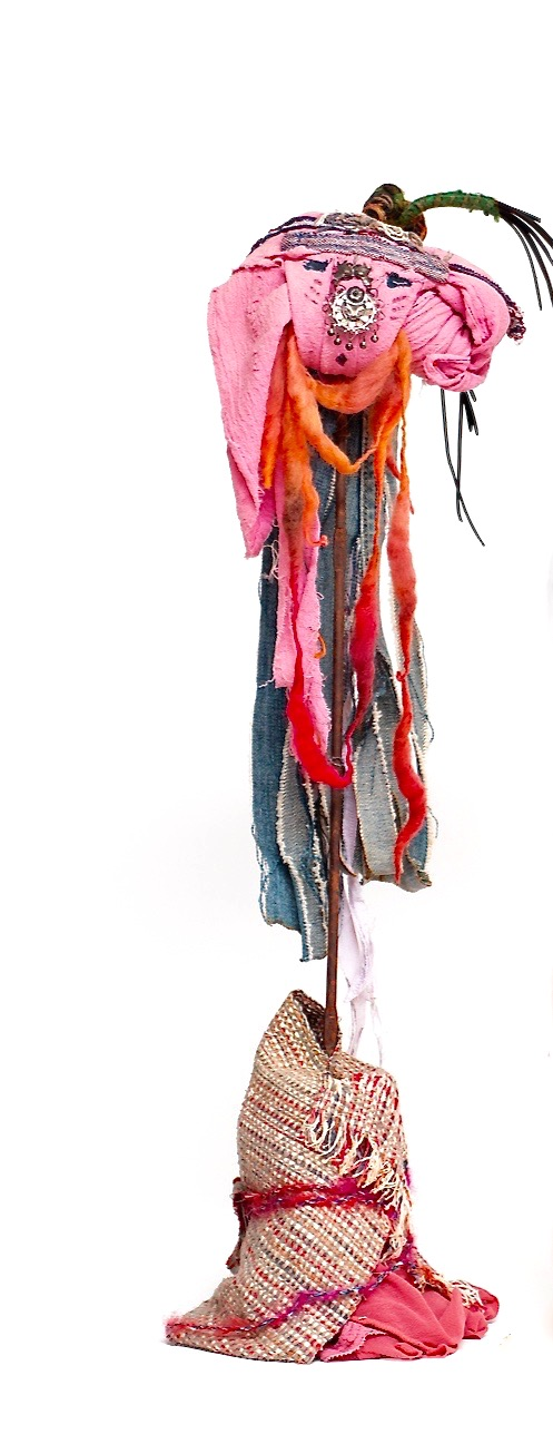 """Curious   Recycled textiles from Turkey, India, Peru, denim, found bungee cord, yarn, threads, paint, acrylic gel and found earring on rusty rebar  Base  rusty tin can with woven textiles, lace, threads, acrylic gel and Japanese fabric  26 x 9"""" round  2017"""