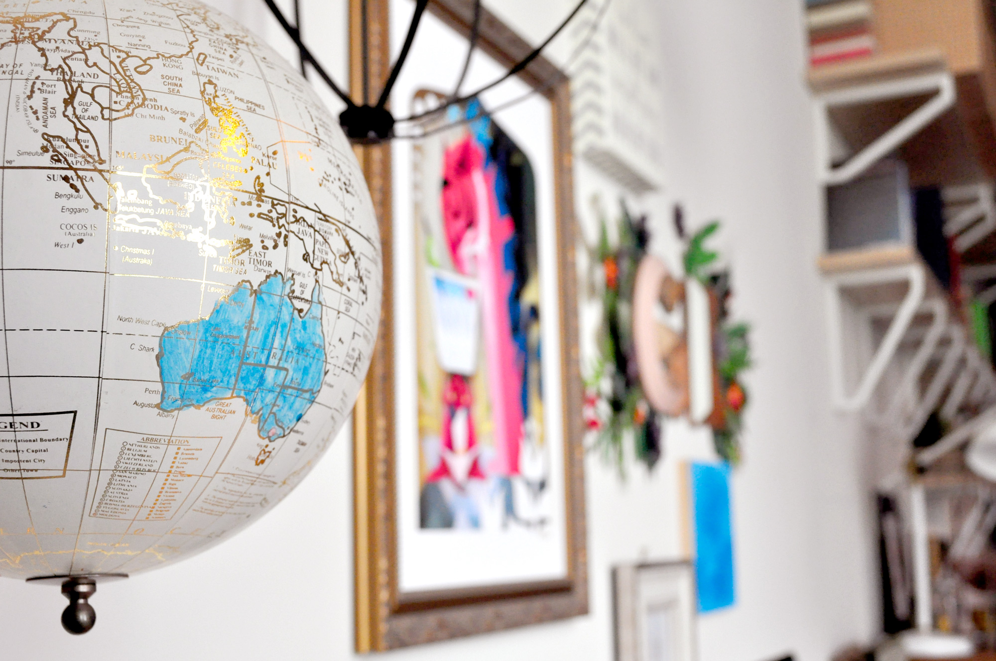 I try to keep this hanging globe updated with all the places my artwork has gone over the years. It's really exciting to see where my works get to travel, and I like to think it's making someone smile is each of those places at any given time.
