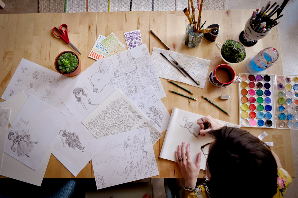 Drawings spread over the studio table