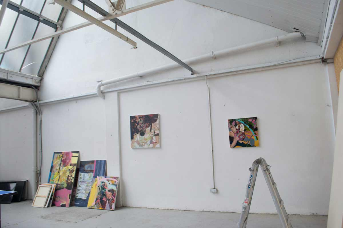 Paintings being photographed in studio