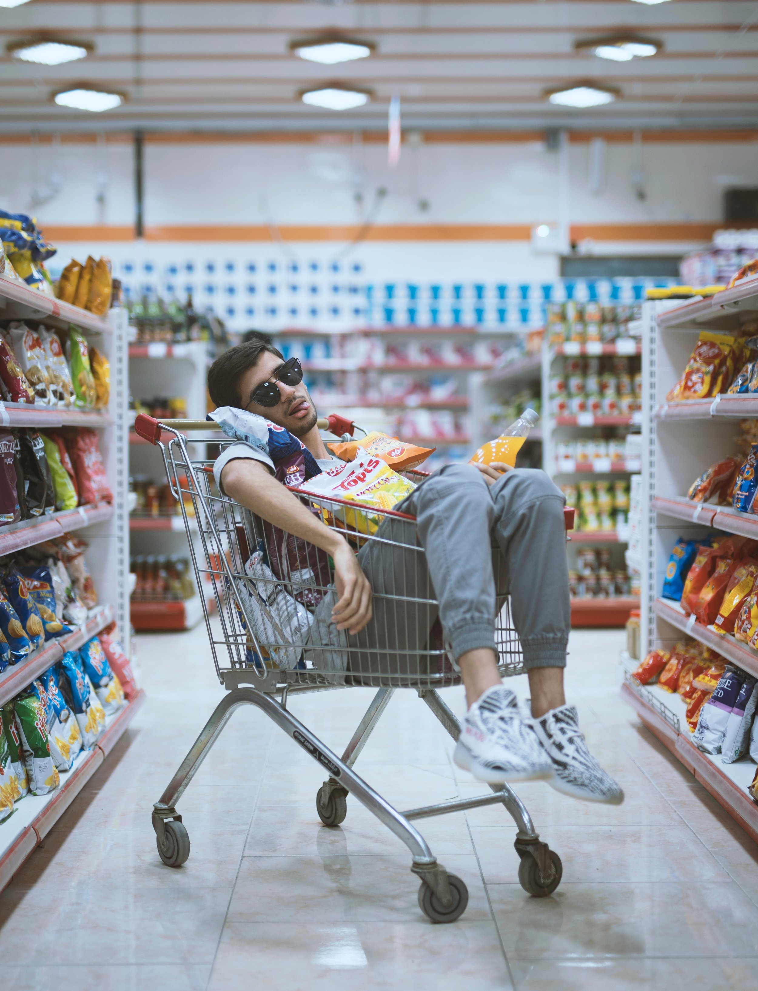 This young man was found after staring at the coffee shelves in the Aisle 5 for too long.  People felt for him and left various items in his cart.  Photo by  Mohammad Sanaei  on  Unsplash