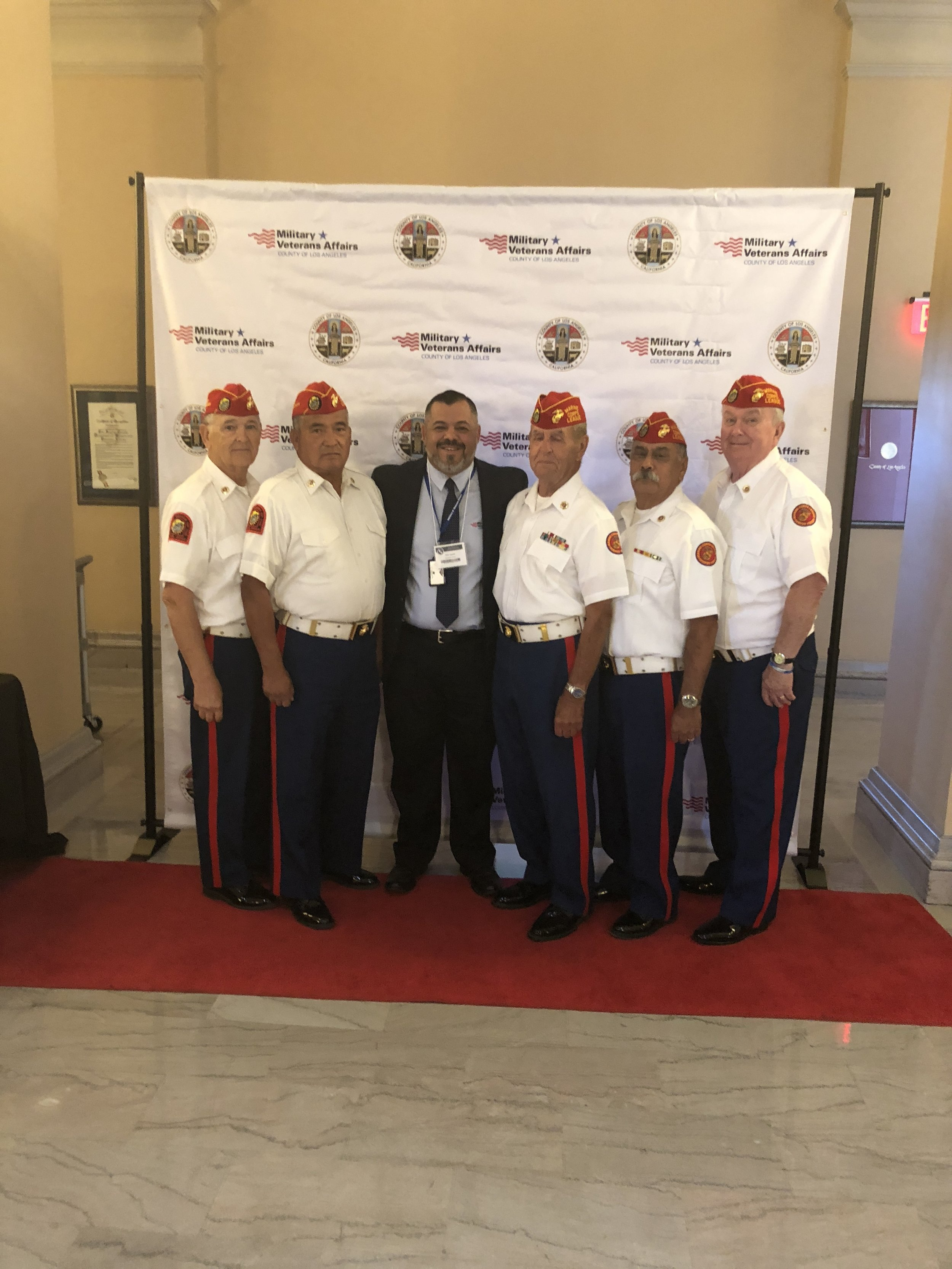 October 1, 2018   Detachment Color Guard for the Los Angeles Country Veterans Administration Fall Conference at the Bob Hope Patriotic Hall in Los Angeles.  L/R: Ben Pfister, Fausto Galvan, VA Service Supervisor Christopher Duarte, John Coley, Harry Hodges, and Dick Jennings.