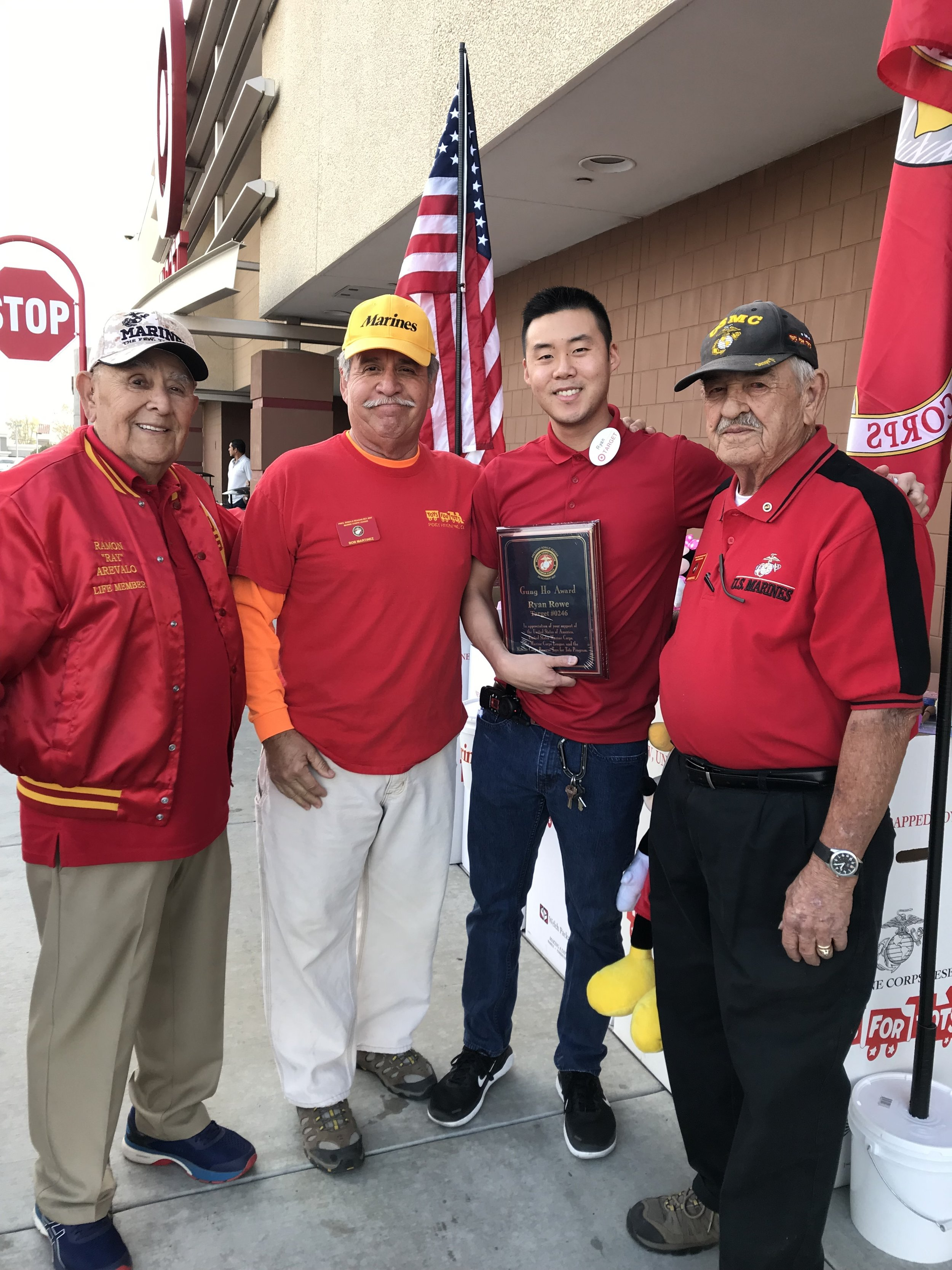 "December 24, 2018   Members of Detachment 597 presenting a ""Plaque of Appreciation"" to Target Store Manager Ryan Rowe for everything he has done for the Toys for Tots Campaign this year.   R/L: John Mitchell (Director of local Toys for Tots), Ryan Rowe (Mgr of Target Store, Sycamore Square), Bob Martinez (Ass't Director of Detachment Toys for Tots), and Ramon Arevalo (Detachment member)."
