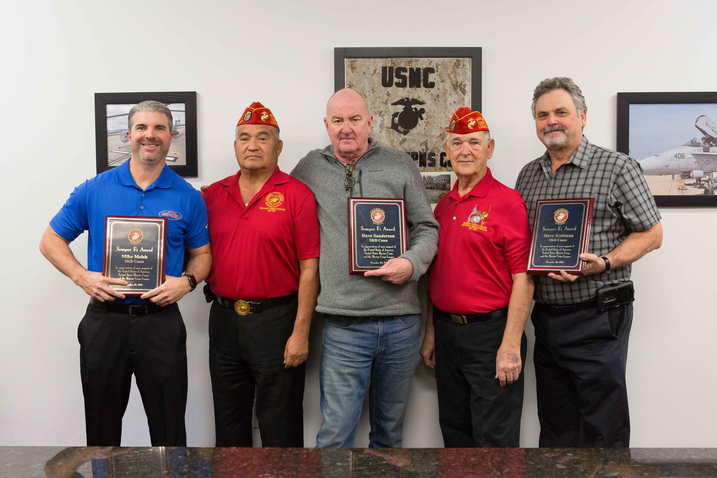 January 5, 2019   Two members of our Detachment (Ben Pfister and Fausto Galvan) traveled to Orange, CA to present 3 plaques to Executives of SKB Cases for their strong support of the Marine Corps League.  L/R: Mike Melsh (Director of Sales, West Coast), Fausto Galvan, Dave Sanderson (Owner), Ben Pfister, and Steve Kottman (Owner).