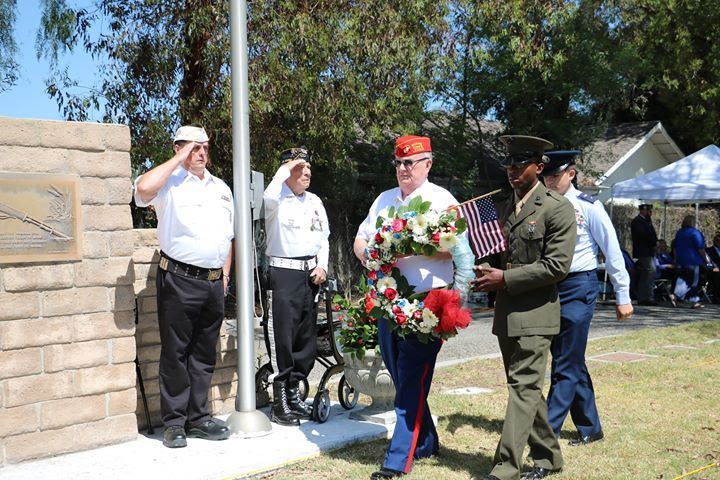 "May 26, 2018   Commandant Jennings and ""Brand New"" Marine Pvt. Demetrius Narsten of Simi Valley place wreath at the 2018 Simi Valley Memorial Day Commemoration Ceremony at Pioneer Cemetery in Simi Valley."