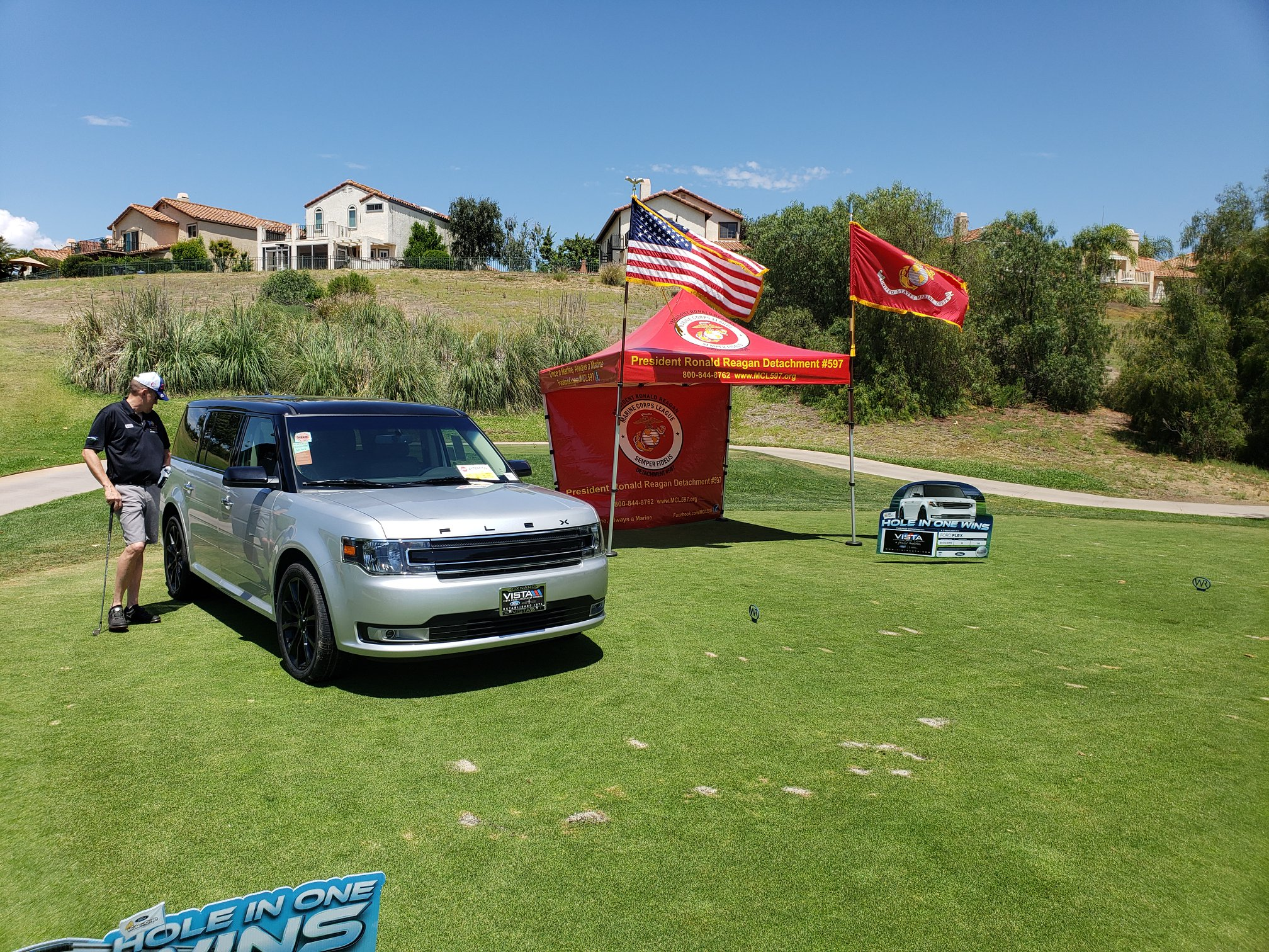 """July 23, 2019   Participated in a terrific Golf Tournament yesterday at the Wood Ranch Country Club, along with John Coley, Jim Wagner and Debbie Sands representing the President Ronald Reagan Det. 597 of the Marine Corps League. It was the 9th Annual Heroes' Golf Tournament sponsored by """"For the Troops."""" This is an organization started by the wife of a Vietnam Veteran and has brought this non-profit company that sends packages to all servicemen/women that are fighting outside the US to be one of the number one charities in the country. It's a terrific charity and Detachment 597 has designated """"For the Troops"""" to be one of their preferential charities.    The photo is our pop-up """"Big Red"""" on the 13th tee, Hole-in-One hole to win that SUV. No one won. I want to thank Paula Cornell for everything she has done for all our active military personnel and Detachment 597."""