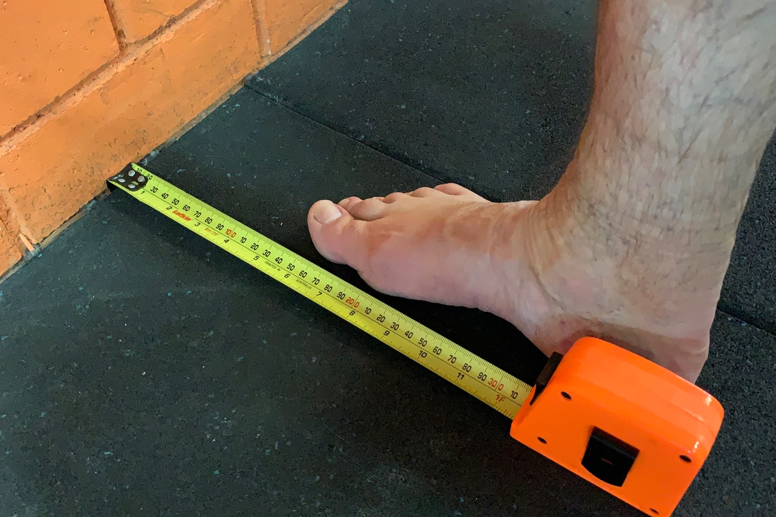 Place your foot with the big toe 13cm out from the wall