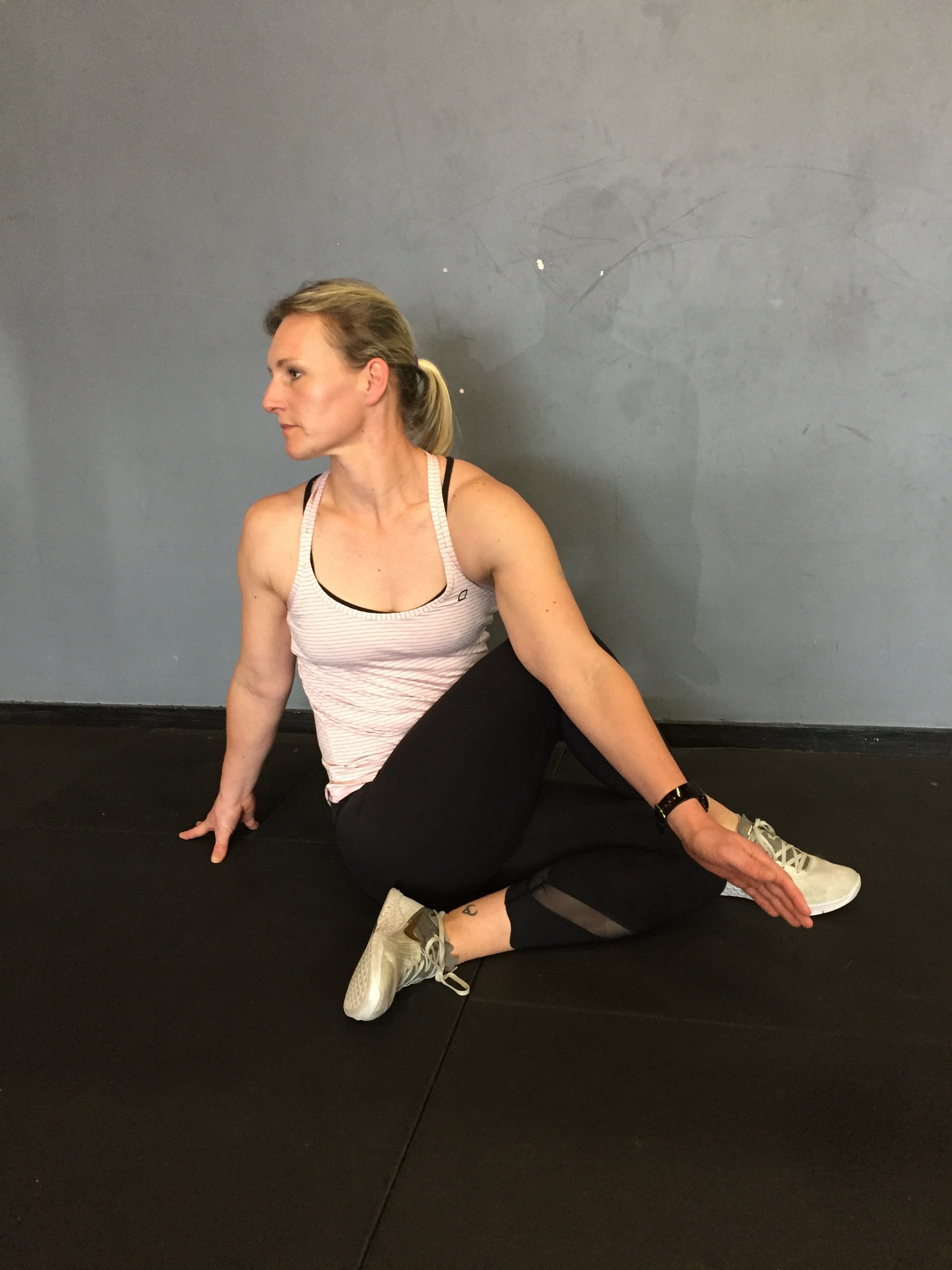 Seated T-spine rotation with both legs bent