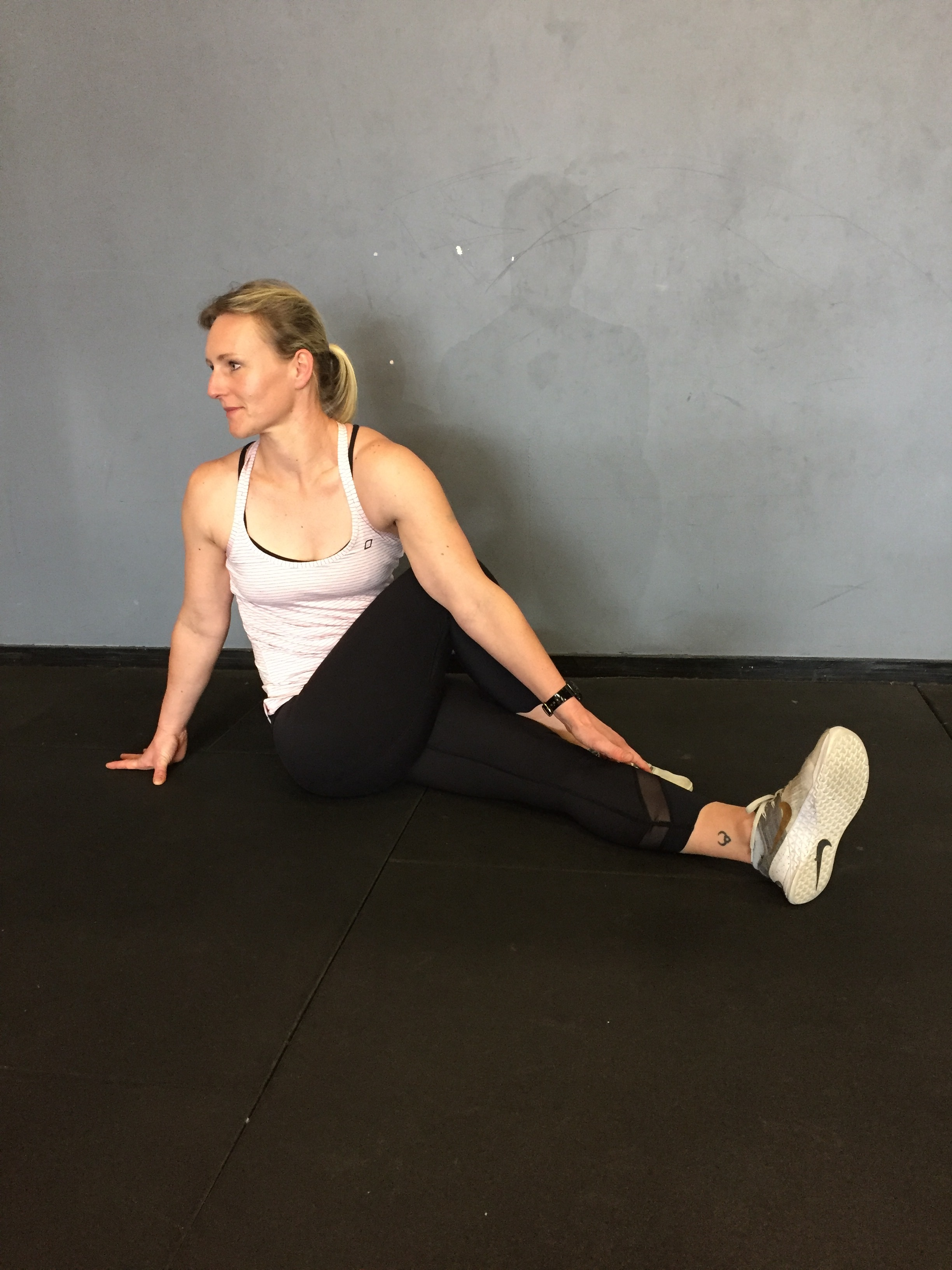 seated T-spine rotation with bottom leg straight