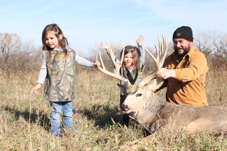 """Clay Thurman  """"I live in Nebraska with my wife Ashley and our daughters Huxley, Josie, and Dixie. We are bowhunters at heart. If you prefer not to be beat up by a girl on the Archery range, don't shoot with my wife. It's really embarrassing. Our time away from work is spent in the timber hunting or in the water hand fishing. I took my first deer with a bow by myself when i was 11. I can't wait for my girls to start hunting! My favorite thing about hunting is the feeling when my arrow hits home after all of the hard work. Mule deer are my favorite animal to chase but I can say with 100% certainty that there is no feeling in the world like the feeling of laying your hands on a mature whitetail."""""""