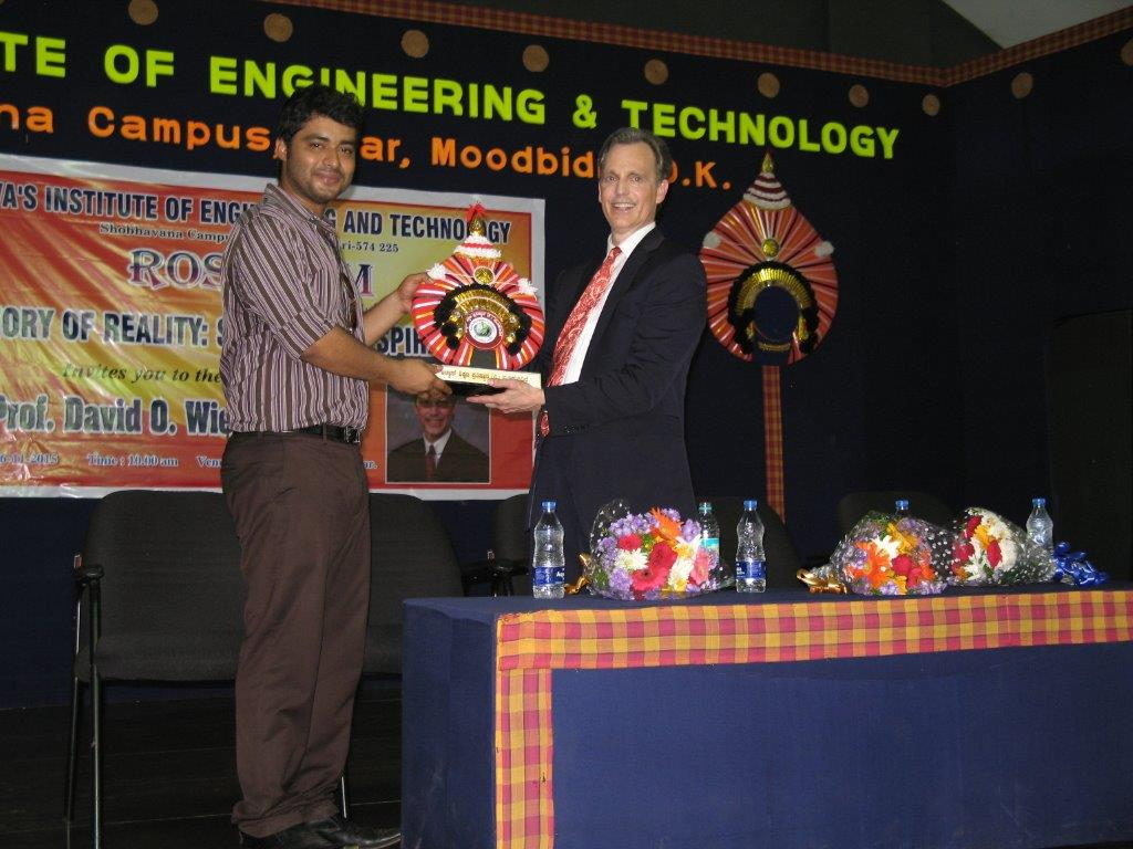 David Wiebers, M.D., accepting an award from Alva College and Educational Foundation outside of Mangalore, India.