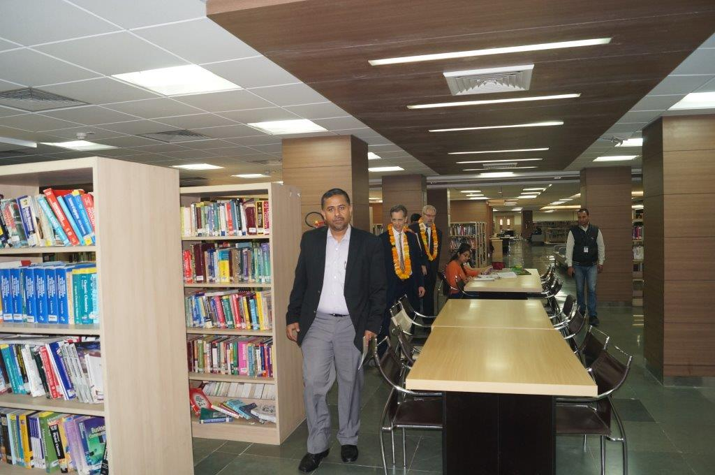 David Wiebers, M.D., touring Amity University Delhi campus library on November 9, 2015.