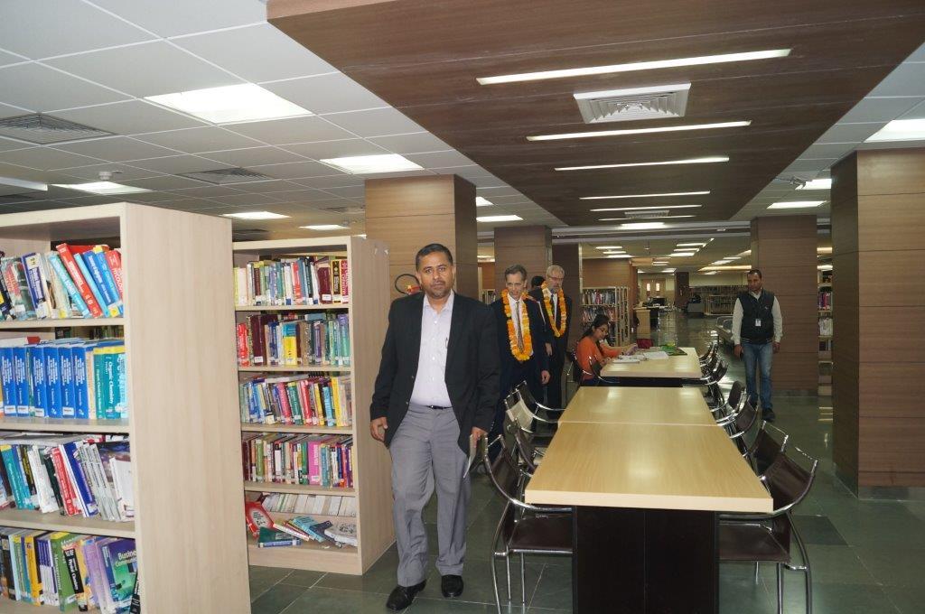 David Wiebers, M.D., touring Amity University Delhi campus library on November 9, 2015.