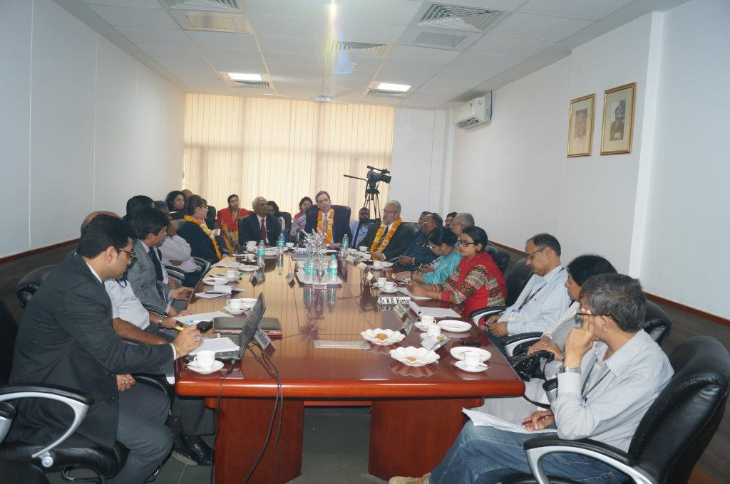 David Wiebers, M.D., and Amity University faculty in the President's conference room prior to touring Amity University Delhi campus on November 9, 2015.