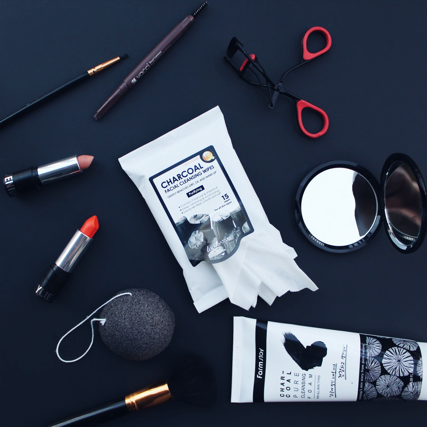 K-beauty products in photo : Auto Eyebrow Pencil, Charcoal Cleansing Wipes, Konjac Root Sponge, and Charcoal Foaming Cleanser.