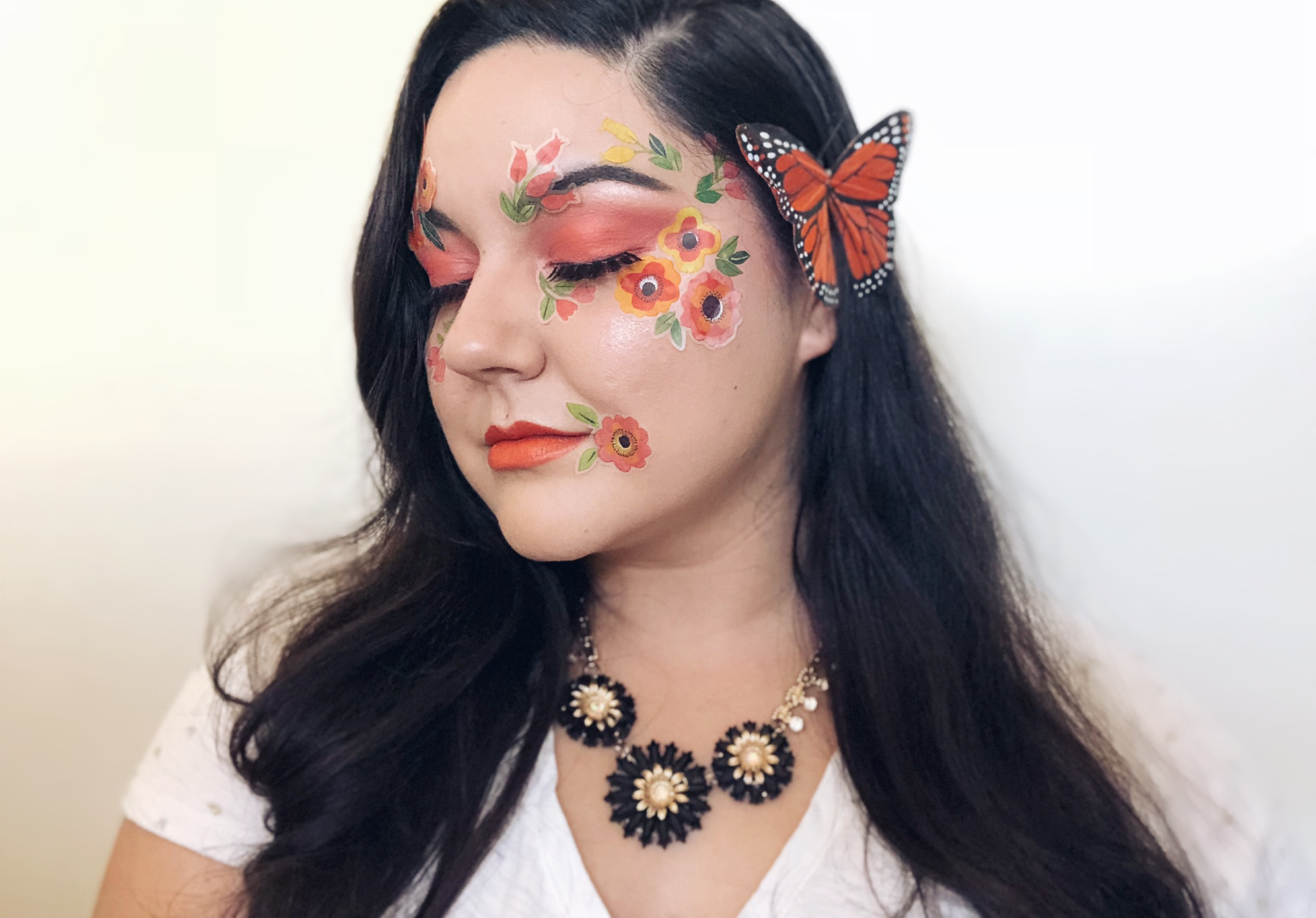floral Halloween makeup look with stickers
