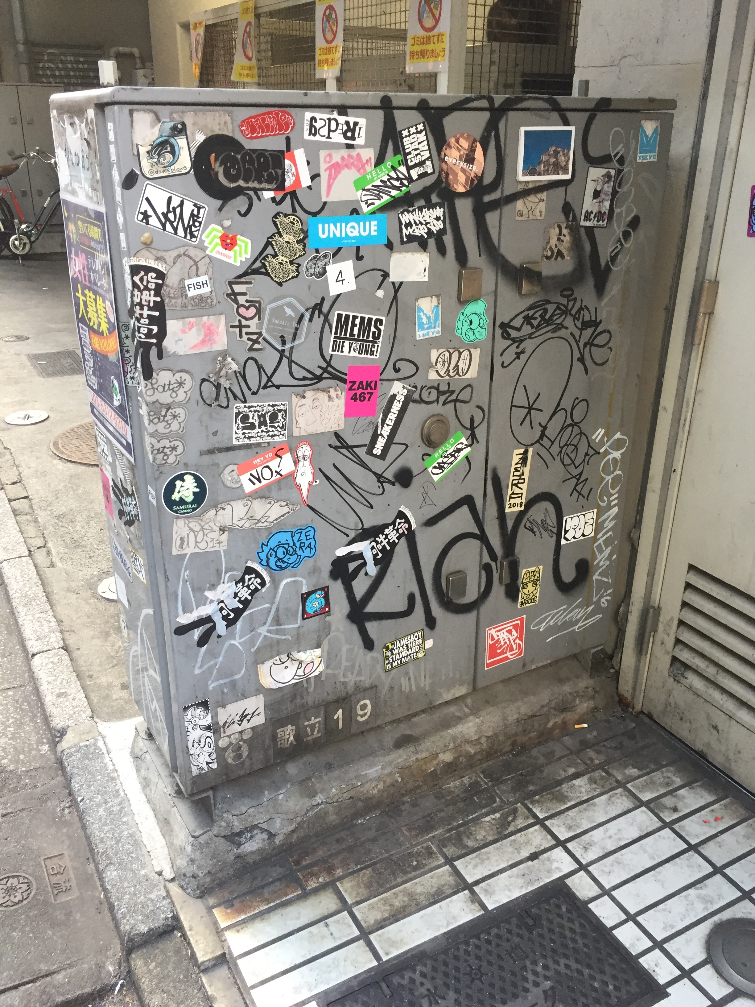 stickers on electrical unit in tokyo.JPG