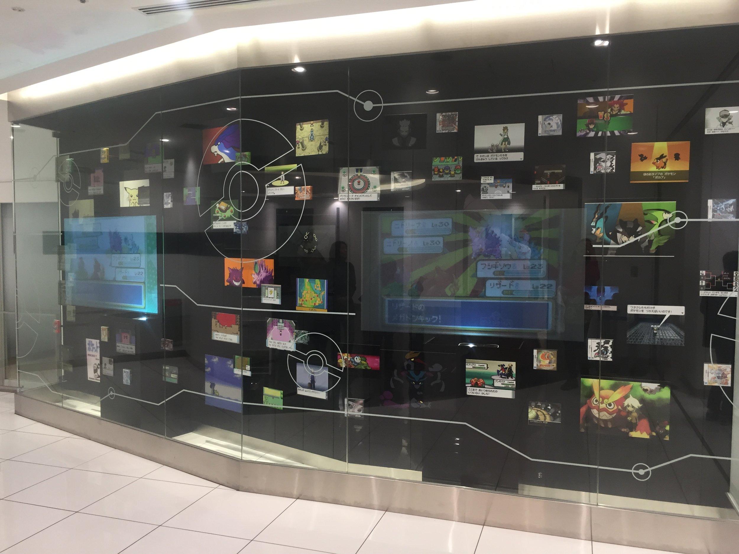 pokemon center display of pokemon history.JPG