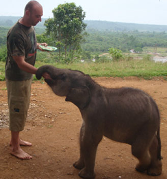 Dr. Christopher Stremme feeding Bona (April, 2011)