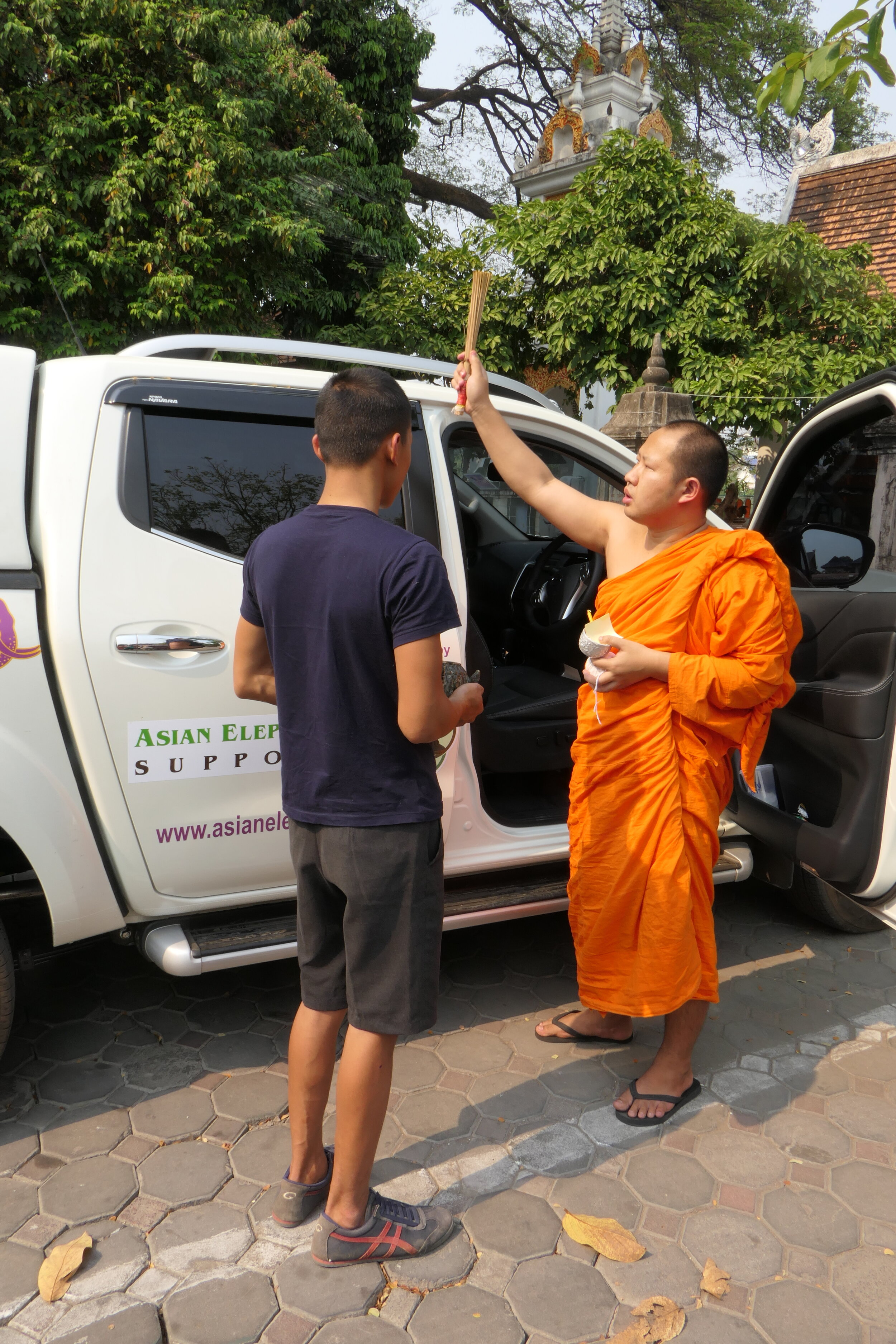 Being blessed by a Buddhist monk