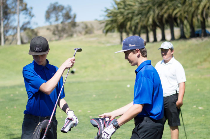 Inaugural season golfers Brett Barry and Daniel Bertschy prepare to tee off at the Marine Memorial Golf Course at the April 18, 2016 match.