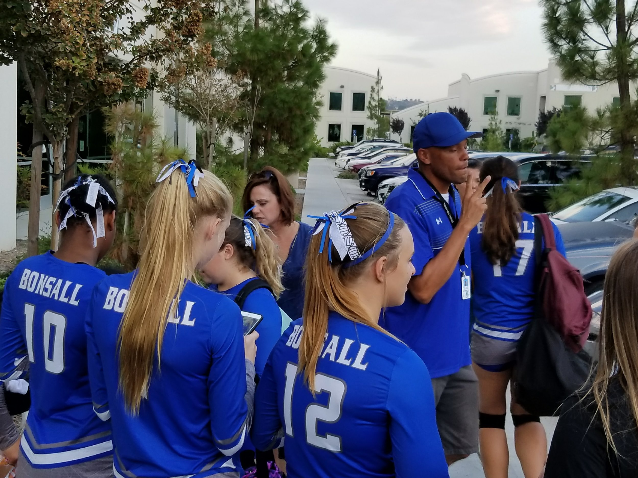 Coach Hendy congratulates the team after their BIG Victory over River Valley, 9/8/17. Bonsall prevailed in a best 3 out of 5 match in their first competition of the pre-season. The team won in 4 games, 23:25, 25:14, 25:20, 25:16.  Ahead in the first game 23:22, the Legion stumbled with 3 unforced errors, but roared back to dominate in the second game and close out the remaining two. River Valley put up a valiant effort but fell short in the remaining games.