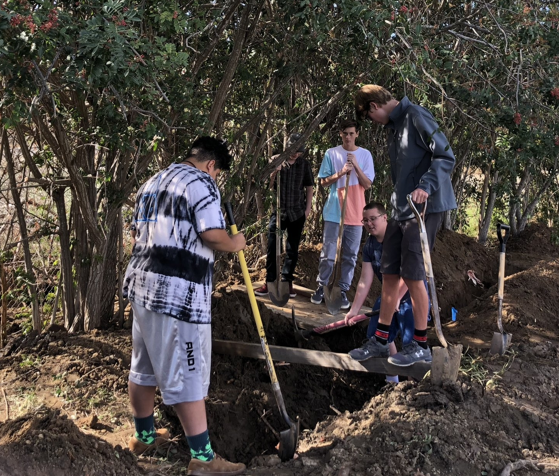 Students using shovels