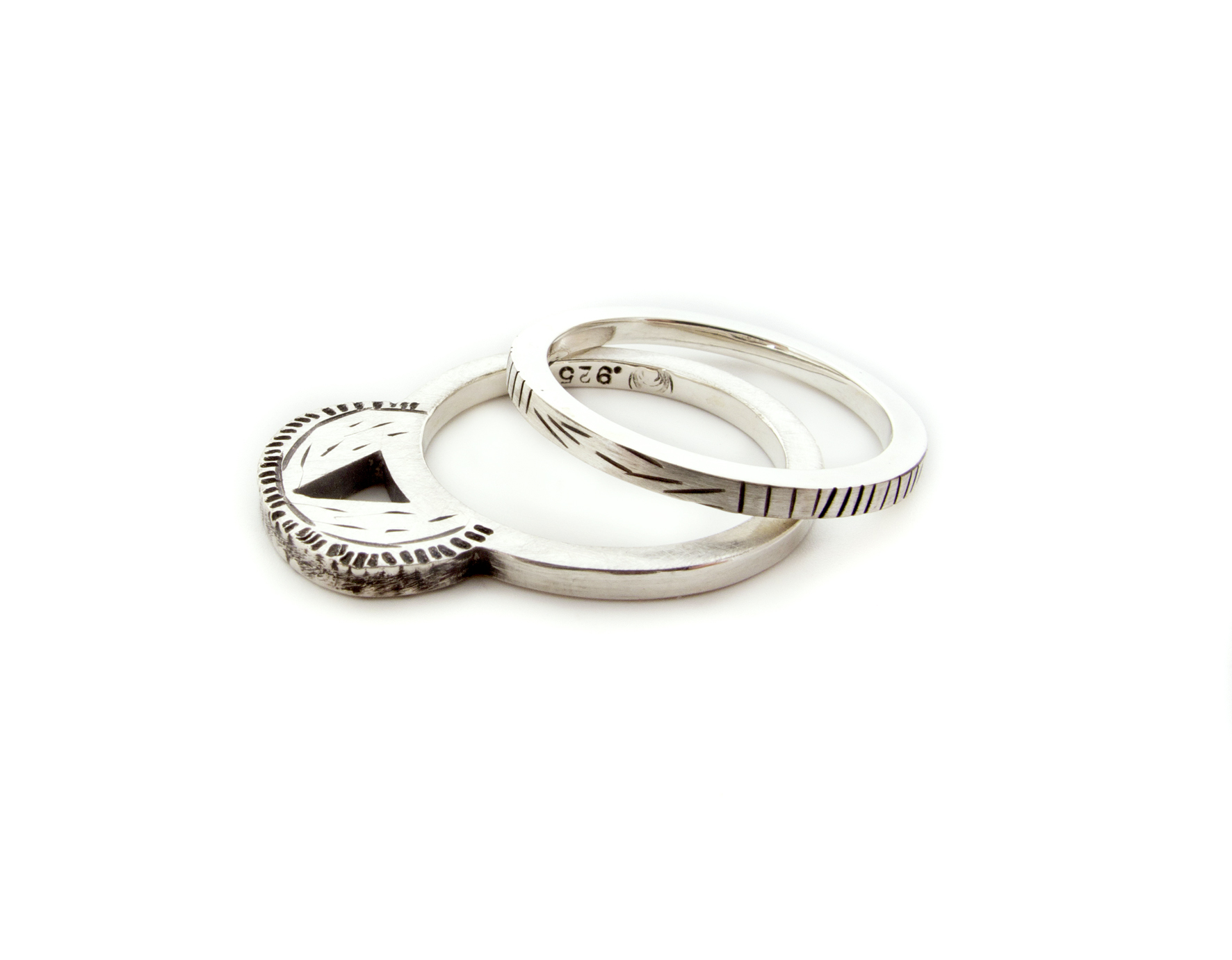 a simplified version of the fancy cactus ring, shown here with the fine lines band, both in sterling silver and sold separately.