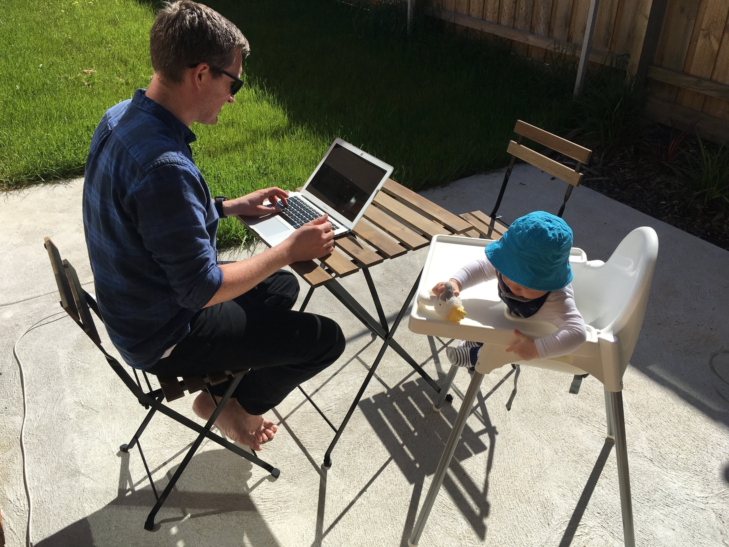 Eric getting some admin work done on a sunny afternoon with Ezra hanging out