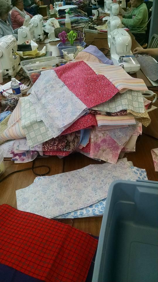 Fibers of love piles of fabric.jpg