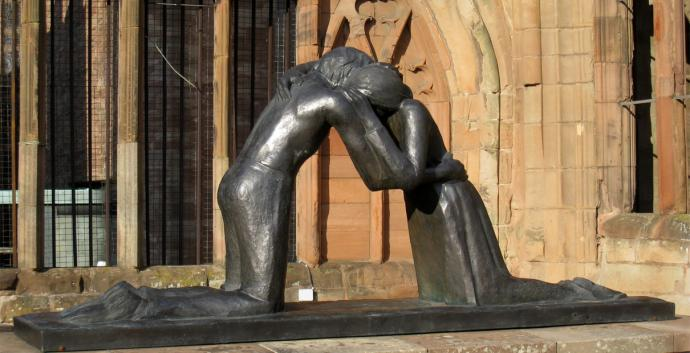 Two former enemies embrace in Vasconcellos' sculpture Reconciliation. Photo by Martinvl, courtesy Wikimedia Commons..jpeg