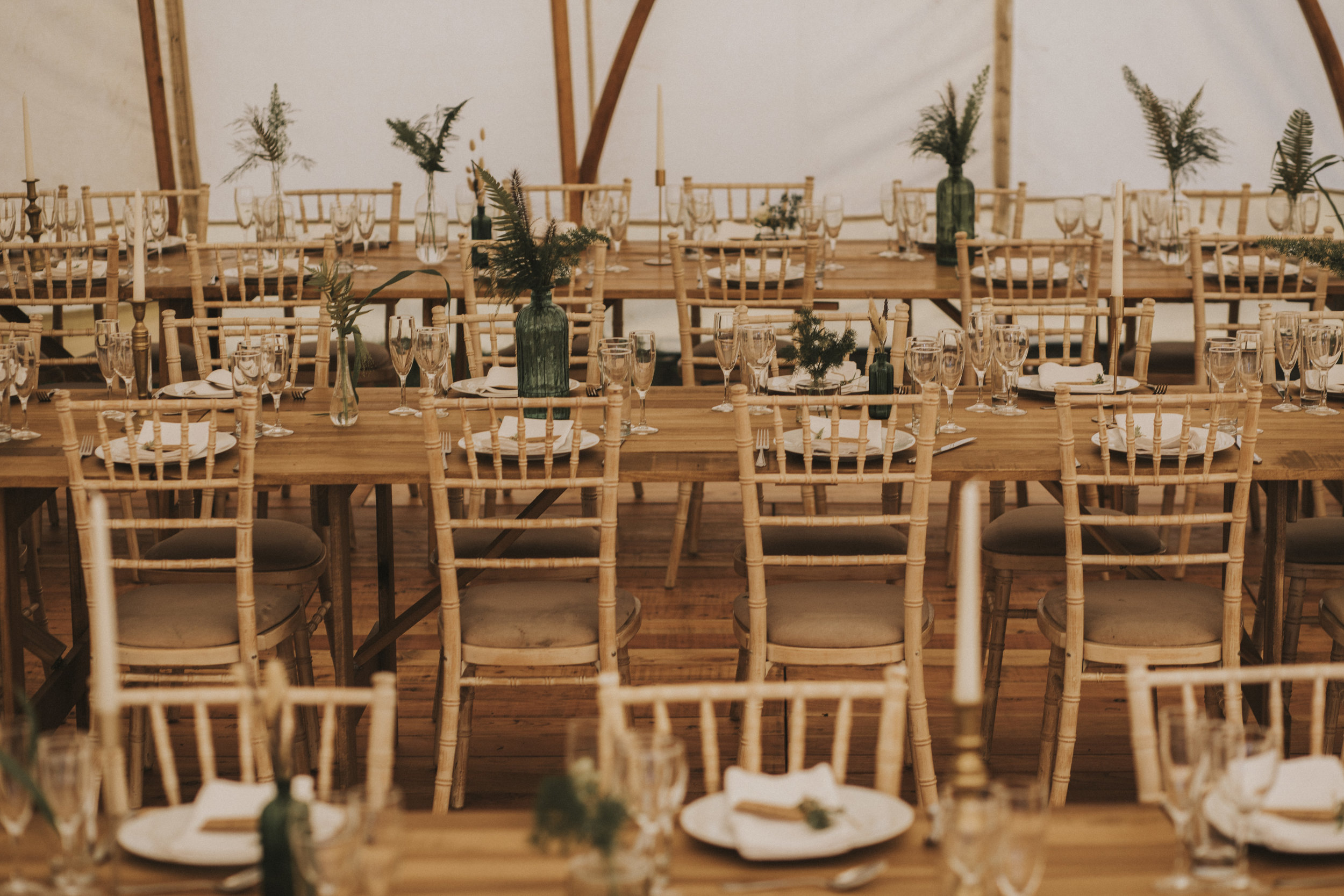 Table and chairs ins sperry tent, festival wedding