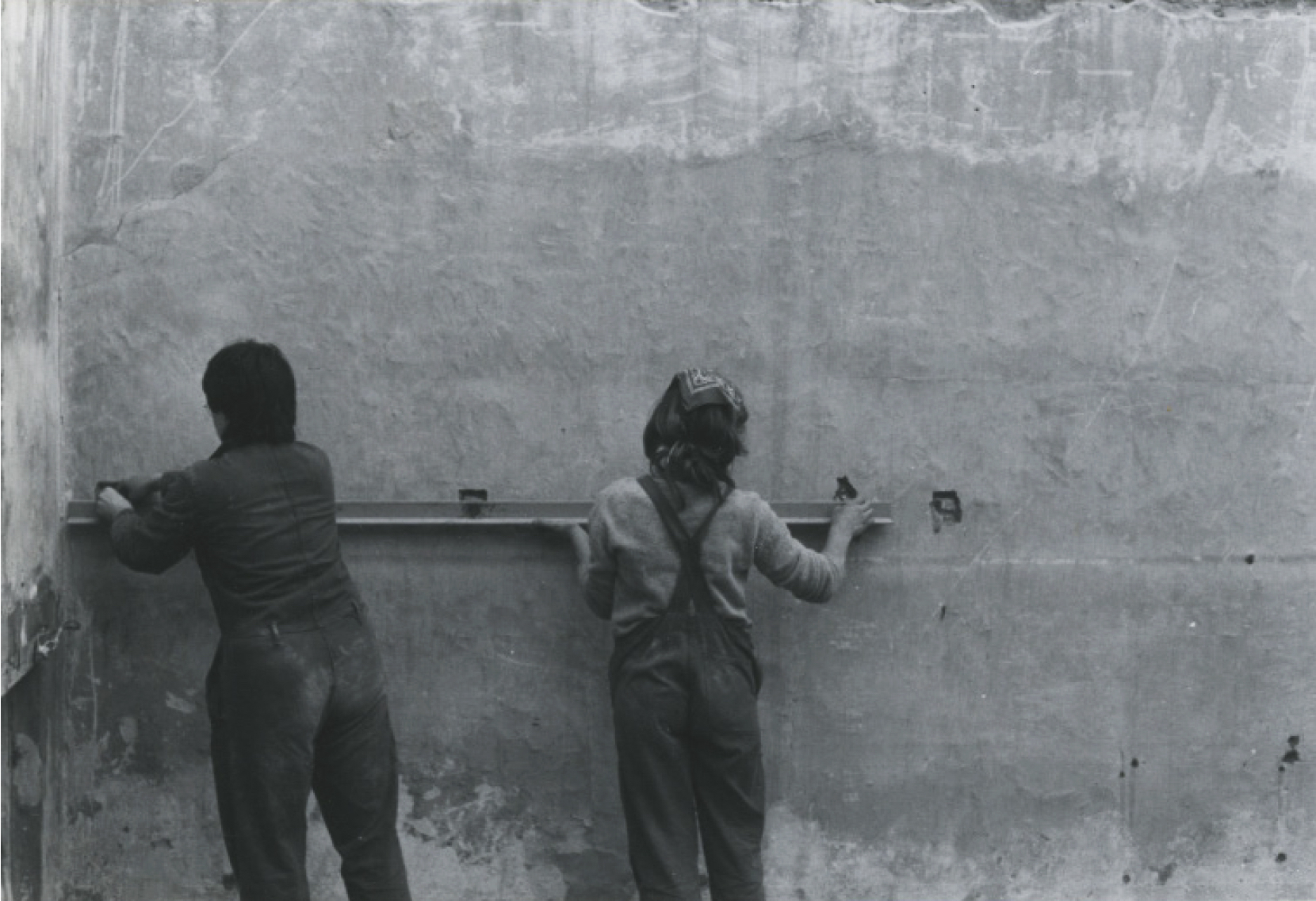 """[Image 3] Research Image. Source: Wall, Christine, """"We don't have leaders! We're doing it ourselves"""", Field Journal, Vol 7(1), page 137. Image credits: Architects Mary-Lou Ascott and Susan Francis, one of the founder members of Matrix, setting out a floor plate."""