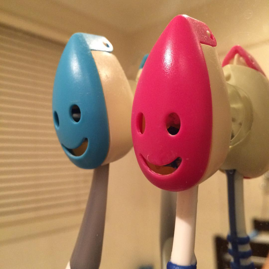 Blue and red toothbrush holders