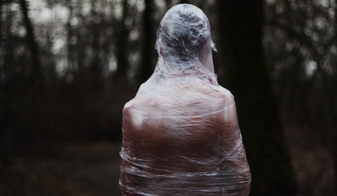 A man covered in foil dies. The nature covered in garbage dies too.