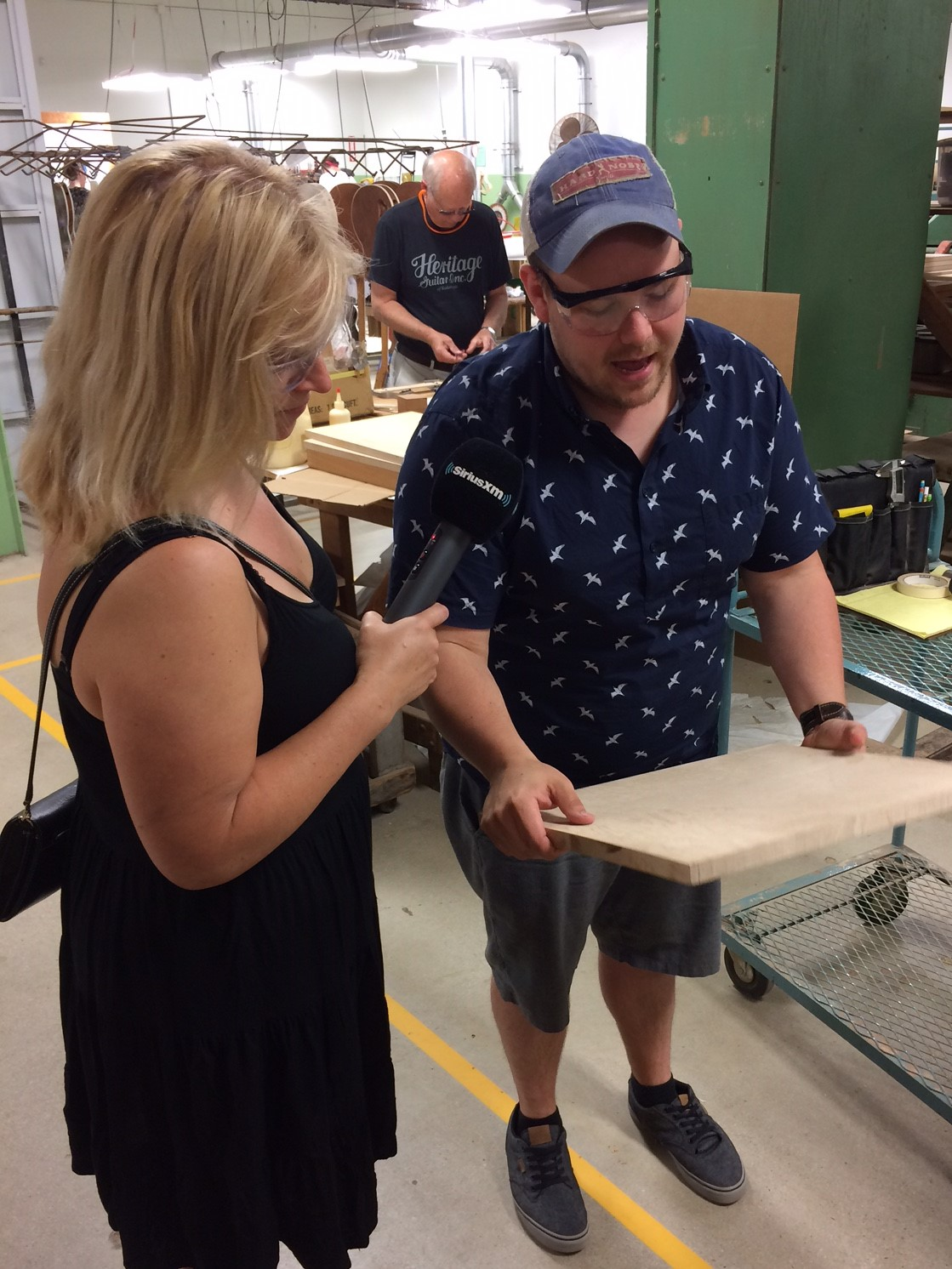 Cara with Ron Howard at Heritage Guitar Inc.JPG