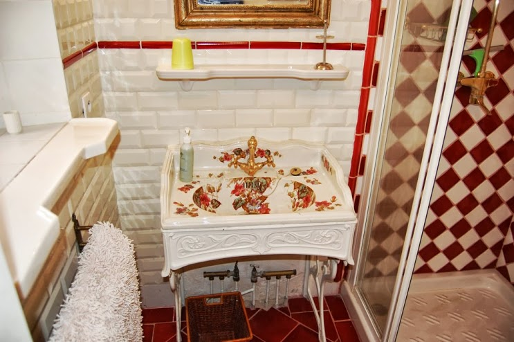 Decorated bathroom with shower and toilet.